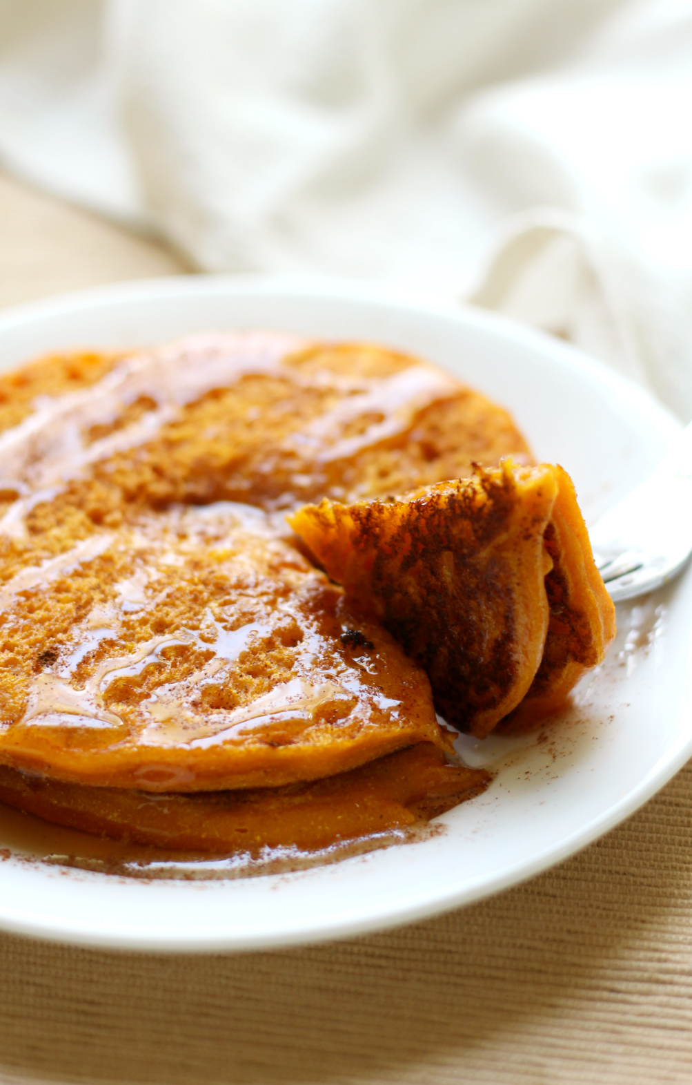 Pumpkin Pancakes | Strength and Sunshine @RebeccaGF666 Simple and delicious pumpkin pancakes in a snap! Gluten-free, vegan, and single-serve, these pancakes are healthy and make a perfect seasonal breakfast recipe any day of the week!