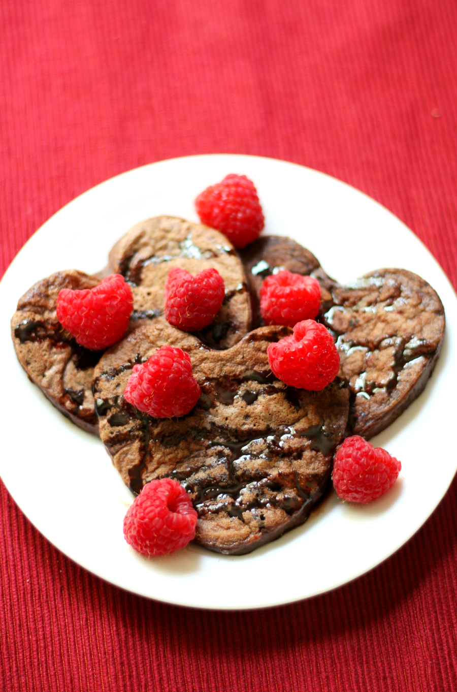 Chocolate Raspberry Heartcakes | Strength and Sunshine @RebeccaGF666 Show someone a little love with a batch of Chocolate Raspberry Heartcakes for a delicious & healthy, but decadent breakfast! A simple pancake recipe that's gluten-free, nut-free, single-serve, & vegan so the love can be shared with all!