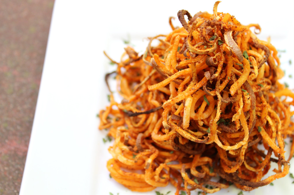 Spicy Spiralized Sweet Potato Fries | Strength and Sunshine @RebeccaGF666 Take your fries to a whole new level. These spicy sweet potato fries are spiralized and baked for the ultimate crispness and seasoned to a spiciness of your liking. Gluten-free, vegan, allergy-free, paleo, and Whole 30 approved, these fries will make your summer cook-outs a little livelier!