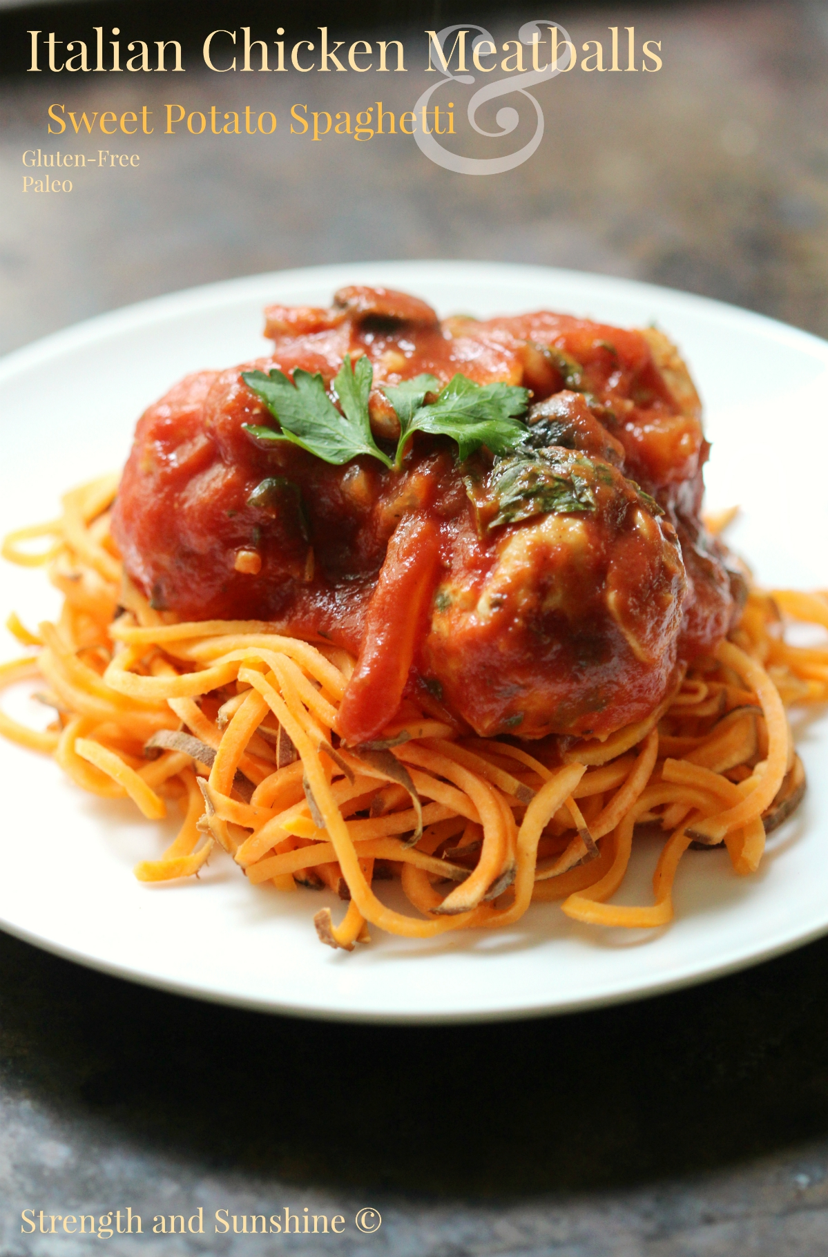 Italian Chicken Meatballs & Sweet Potato Spaghetti | Strength and Sunshine @RebeccaGF666 Italian chicken meatballs baked and simmered in a homemade tomato sauce, served over easy sweet potato spaghetti. Gluten-free, allergy-free, and paleo, this delicious version of the classic will quickly become a new family dinner favorite. #sponsored #TheRecipeReDux