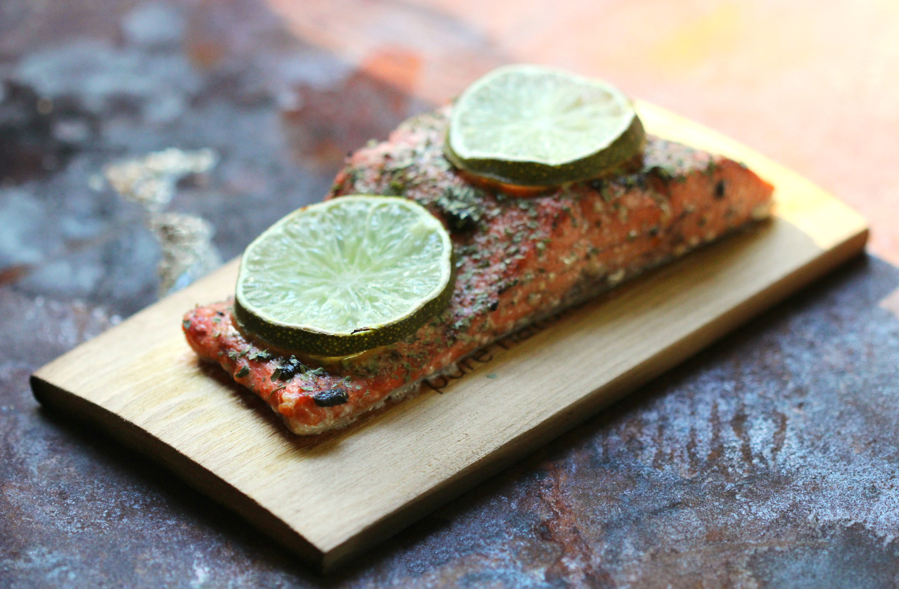 Black Garlic & Lime Cedar Plank Salmon | Strength and Sunshine @RebeccaGF666 Black garlic and lime add even more flavor to smoky grilled cedar plank salmon. You won't have to wait long for this paleo and gluten-free recipe to be cooked up; it's done in a snap and will surly satisfy! Perfect for a quick dinner or lunch!