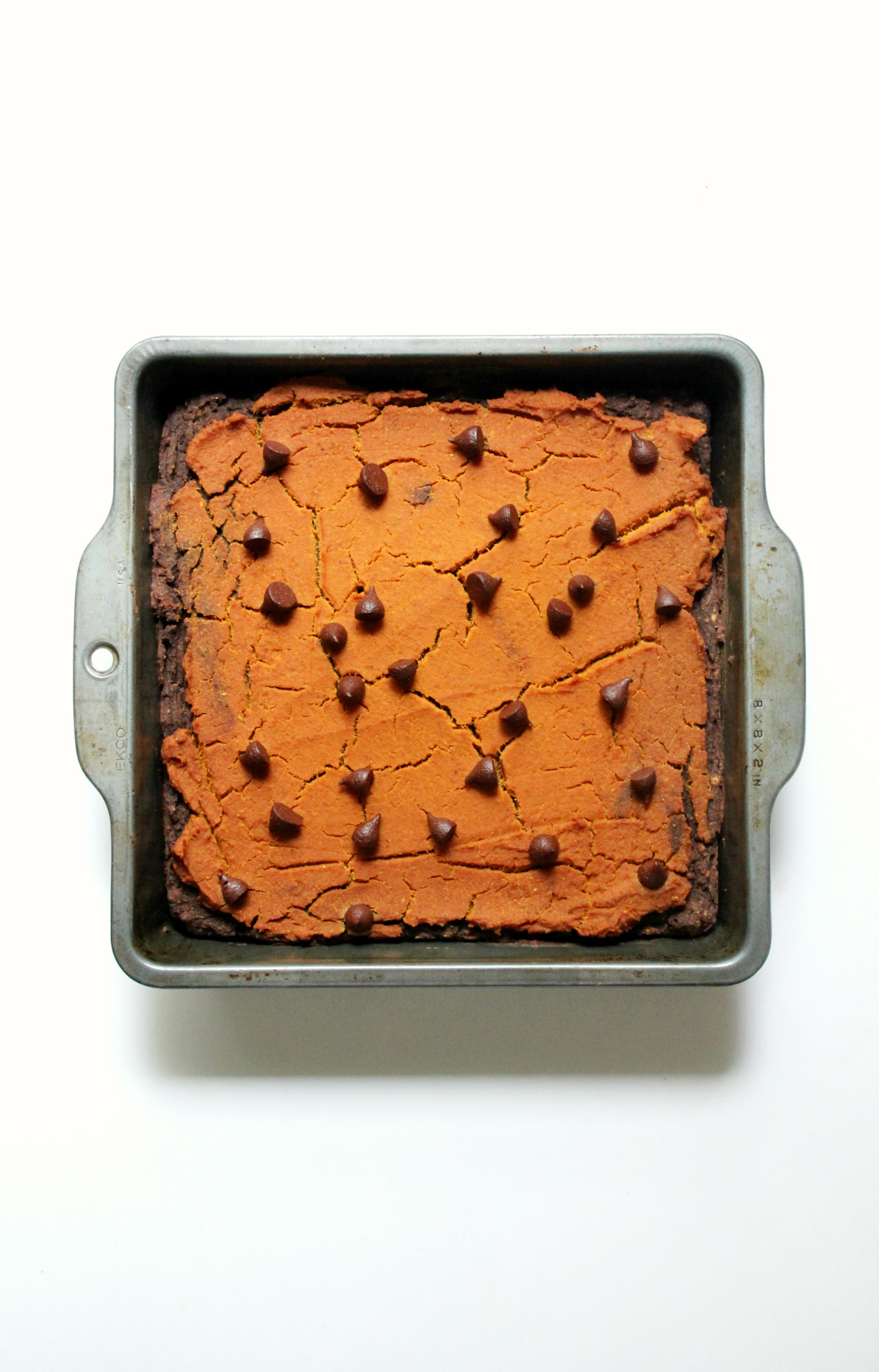 Pumpkin Peanut Butter Layer Brownies | Strength and Sunshine @RebeccaGF666 Where pumpkin, peanut, and chocolate combine! Pumpkin Peanut Butter Layer Brownies will make you rethink your definition of brownie. These gluten-free and vegan brownies are the healthiest of holiday indulgences, you won't have to stop at one! They can be dessert or breakfast!