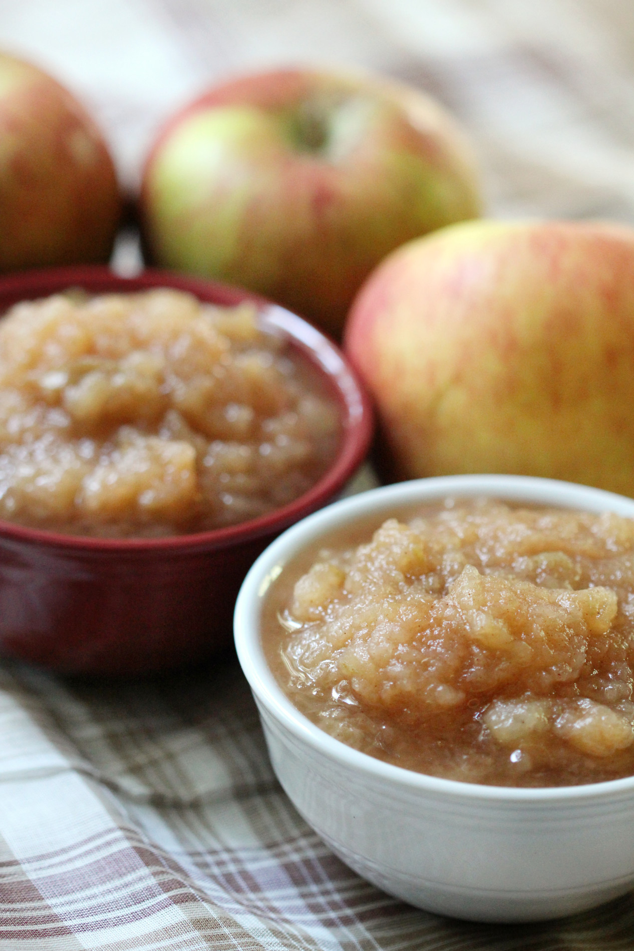 Slow Cooker Applesauce | Strength and Sunshine @RebeccaGF666 Nothing smells more like autumn comfort than apples simmering in the slow cooker! Easy homemade slow cooker applesauce with none of the work, hassles, or added sugar. Add some cinnamon and spice or keep it plain; the final product is up to you but will always be delicious! The perfect gluten-free and vegan sweet snack!