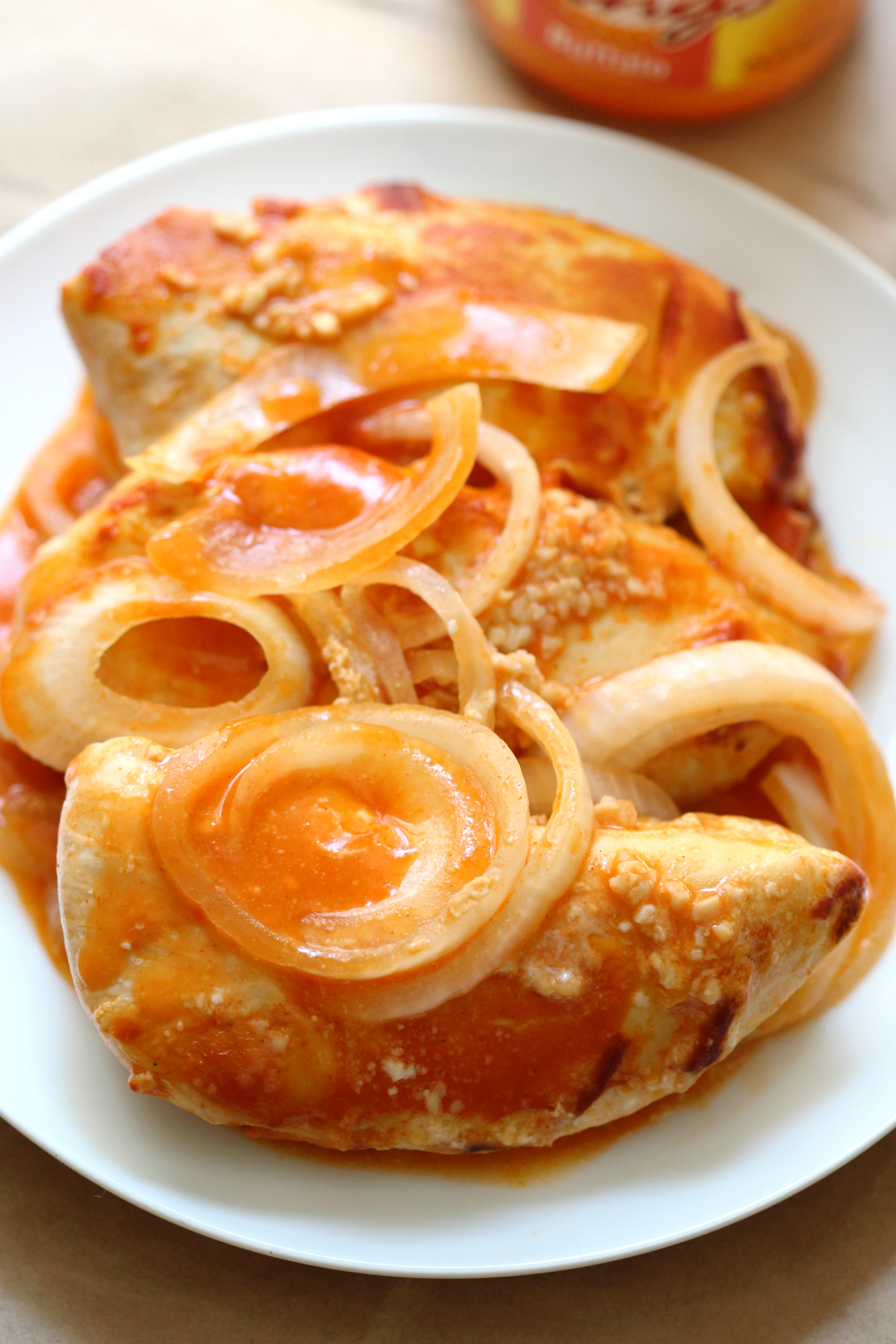 Slow Cooker Buffalo Chicken | Strength and Sunshine @RebeccaGF666 Grab your slow cooker, it's time for a hot and spicy meal! Thrown together in seconds, but full of flavor, gluten-free, dairy-free, paleo, and with a secret to the creaminess; slow cooker buffalo chicken is the perfect weeknight dinner recipe!