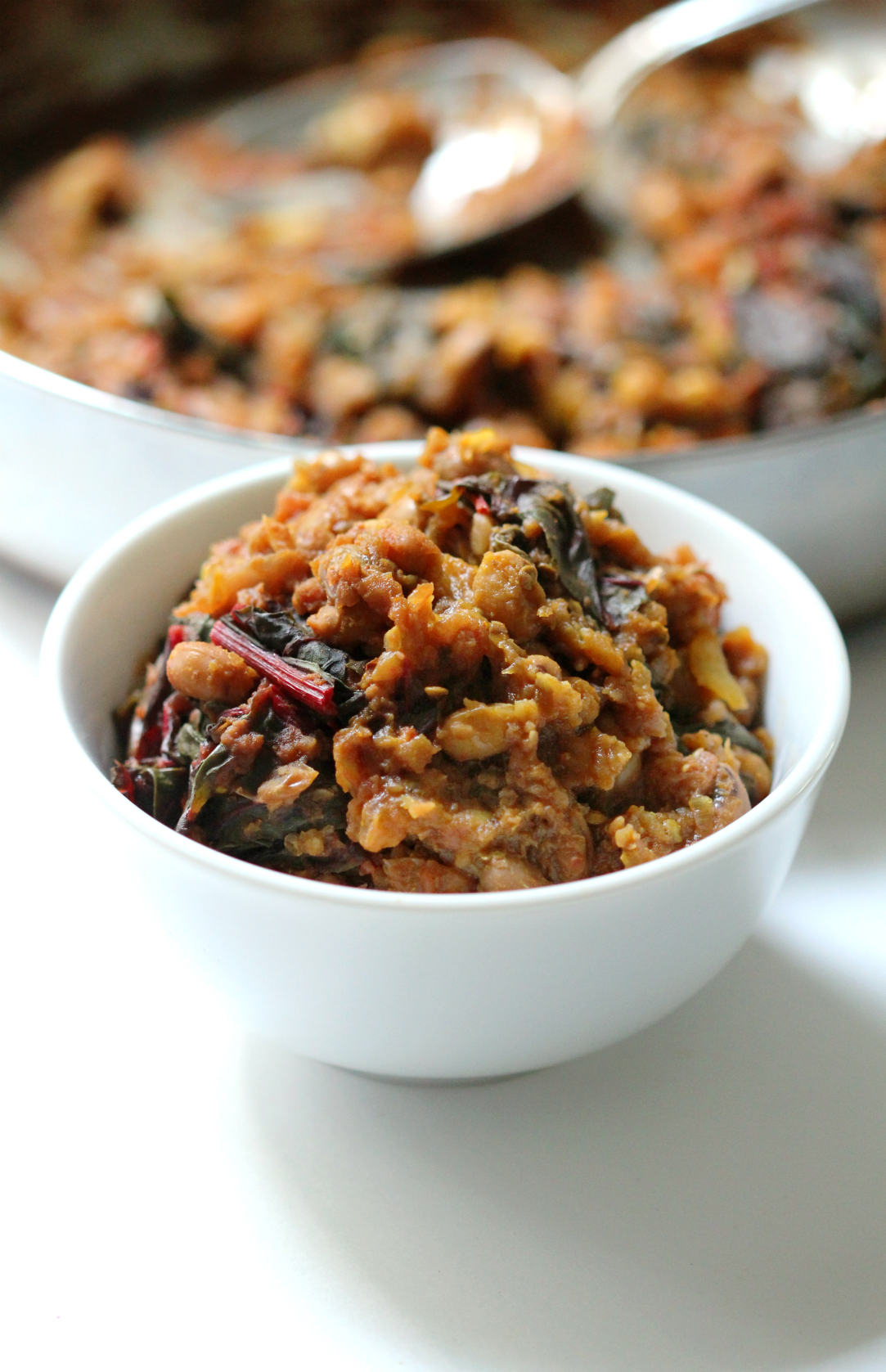 Black Eyed Pea Curry with Swiss Chard & Roasted Eggplant | Strength and Sunshine @RebeccaGF666 An easy quick curry for a warming meal any night of the week. Black Eyed Pea Curry with Swiss Chard & Roasted Eggplant is packed with creamy veggie power to satisfy even this biggest plant-based skeptic! A perfect gluten-free, vegan, meatless dinner recipe.