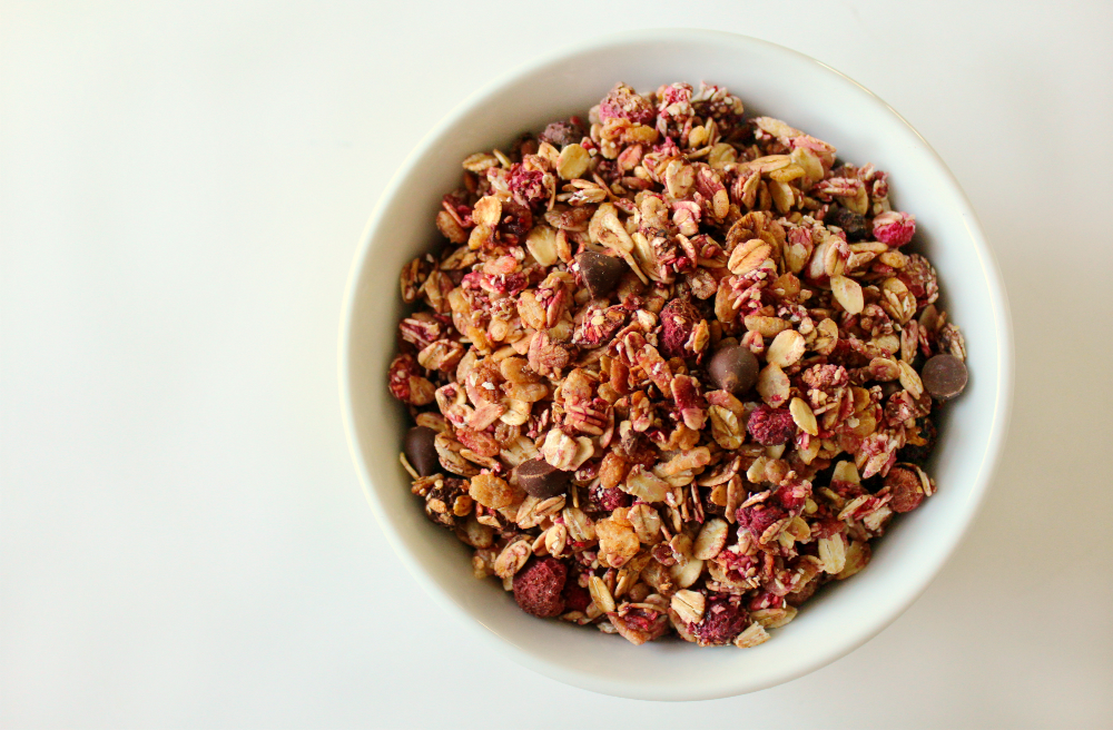 Chocolate Chip Raspberry Granola | Strength and Sunshine @RebeccaGF666 Perfectly sweet and tart, chocolate chip raspberry granola makes a lovely healthy breakfast or snack. Gluten-free. nut-free, and vegan with just a few simple ingredients, your granola craving can be satisfied in a snap!