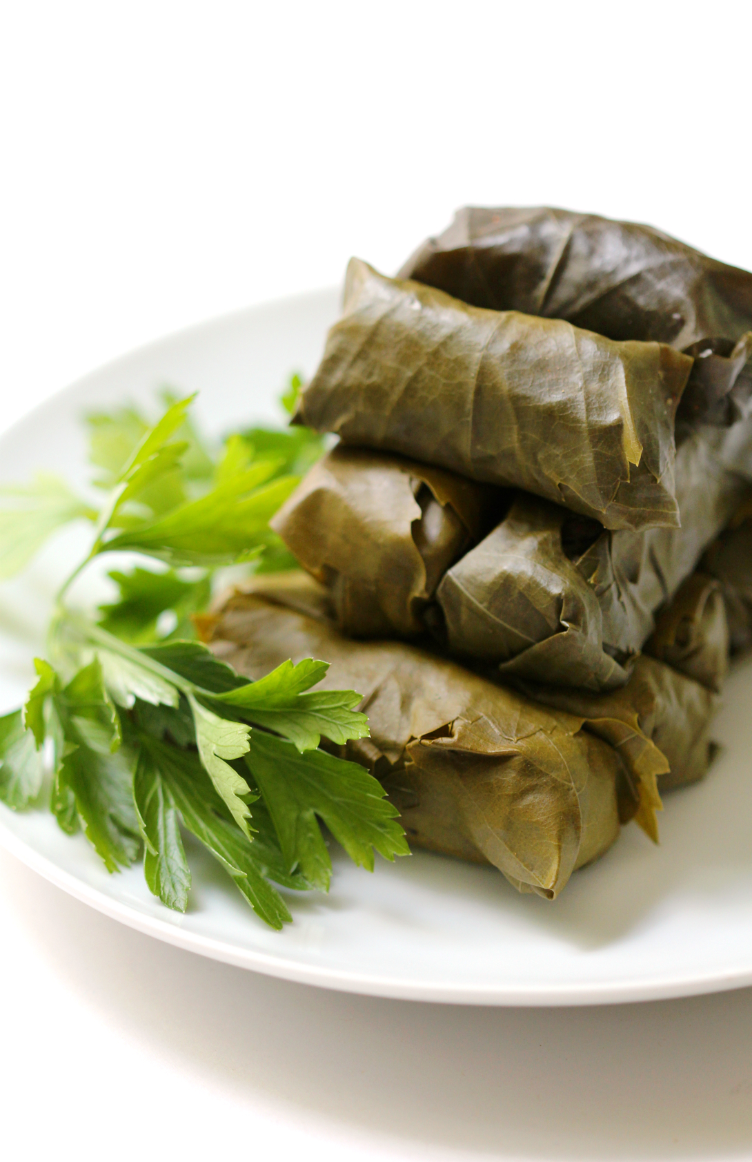Vegan Rice Stuffed Dolmades | Strength and Sunshine @RebeccaGF666 A Mediterranean classic made vegan and gluten-free. Rice stuffed dolmades (grape leaves) full of fresh herbs, roasted eggplant, olives, spices, and aromatic basmati rice! A fantastic appetizer, side, or main dish!