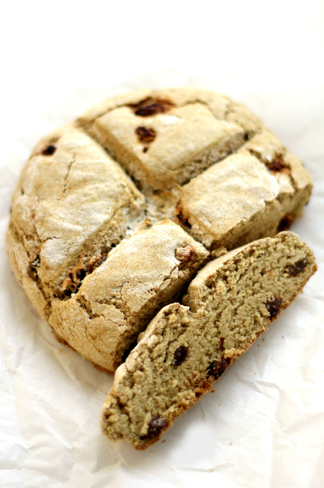 Traditional Gluten-Free Irish Soda Bread | Strength and Sunshine @RebeccaGF666 Everything a traditional Irish soda bread should be, only this one is gluten-free and vegan! A simple flour blend and spotted with raisins, everyone will feel the luck of the Irish with this simple soda bread recipe!