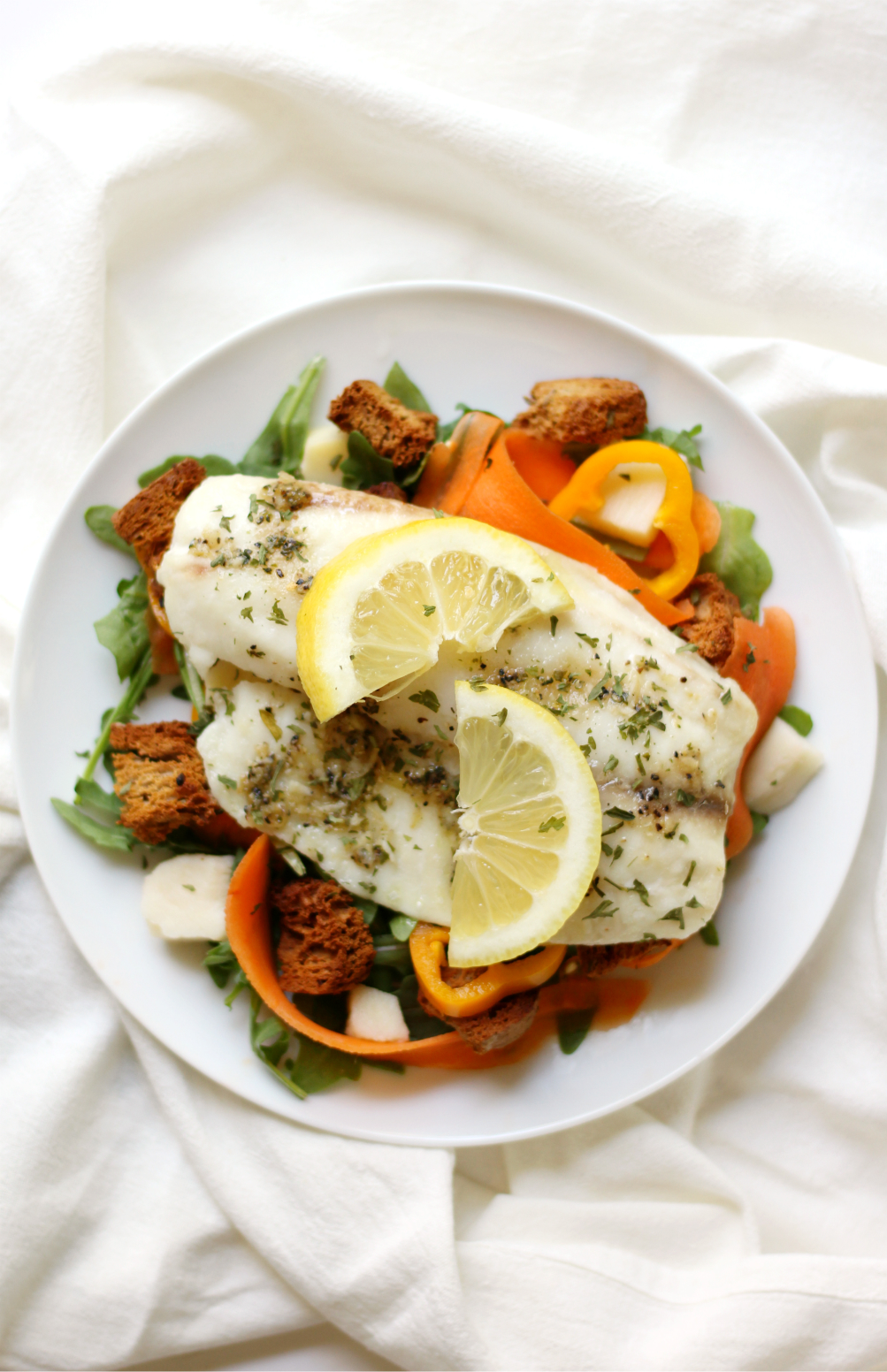 Lemon Pepper Tilapia + Spring Arugula Salad & Homemade Garlic Herb Croutons | Strength and Sunshine @RebeccaGF666 A simple spring weeknight dinner recipe for lemon pepper tilapia with a fresh arugula salad and homemade gluten-free, dairy-free garlic herb croutons! Ready in 20 minutes or less so you have time to sit down and enjoy!