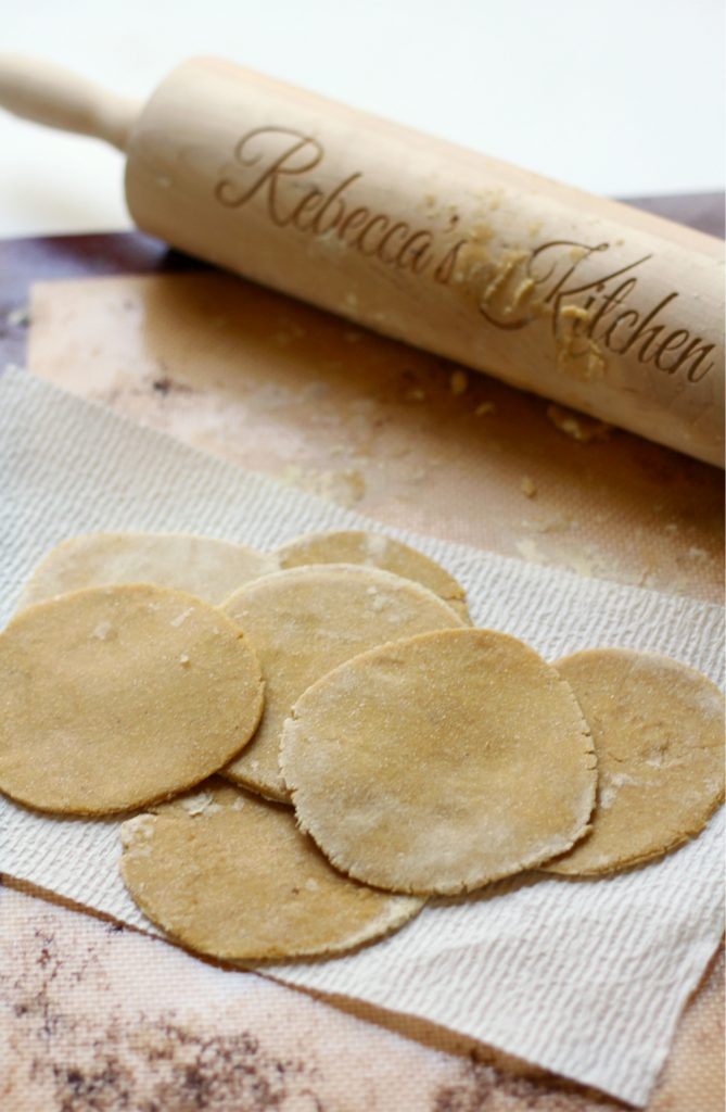 Sauerkraut Chickpea Flour Ravioli + Spiced Applesauce | Strength and Sunshine @RebeccaGF666 Homemade sauerkraut filled chickpea flour ravioli in seconds! Mix, roll, cut, stuff, boil! The simplicity of a gluten-free, grain-free, nut-free, egg-free, dairy-free, and vegan dinner recipe that's healthy and flavorful with the saltiness of sauerkraut and sweet spice of an applesauce topping!