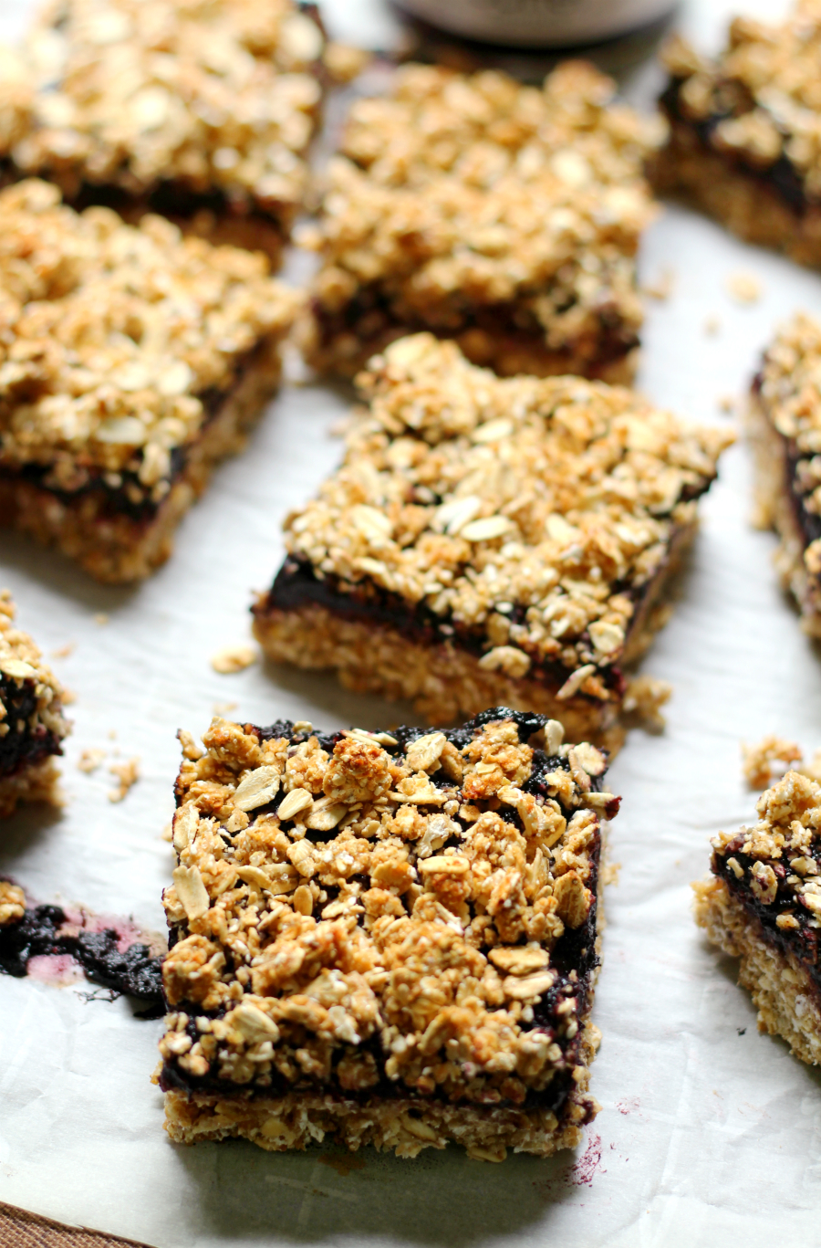 Peanut Butter & Jelly Crumble Bars | Strength and Sunshine @RebeccaGF666 Everyone's childhood favorite sandwich baked into a delicious gluten-free and vegan bar! Peanut Butter & Jelly Crumble Bars that can be eaten for breakfast, lunch, as a snack, or dessert! This healthy bar recipe will have you ditching the bread!