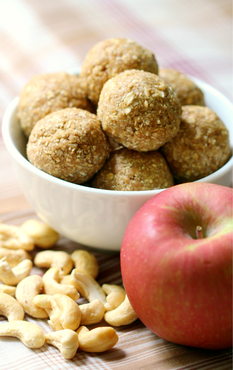 Apple Cashew Snack Bites | Strength and Sunshine @RebeccaGF666 A sweet little no-bake snack bite that's great for school, work, and on the go! These Apple Cashew Snack Bites are gluten-free, vegan, made right in a food processor, and freezer-friendly! A make-ahead recipe to always keep on hand!