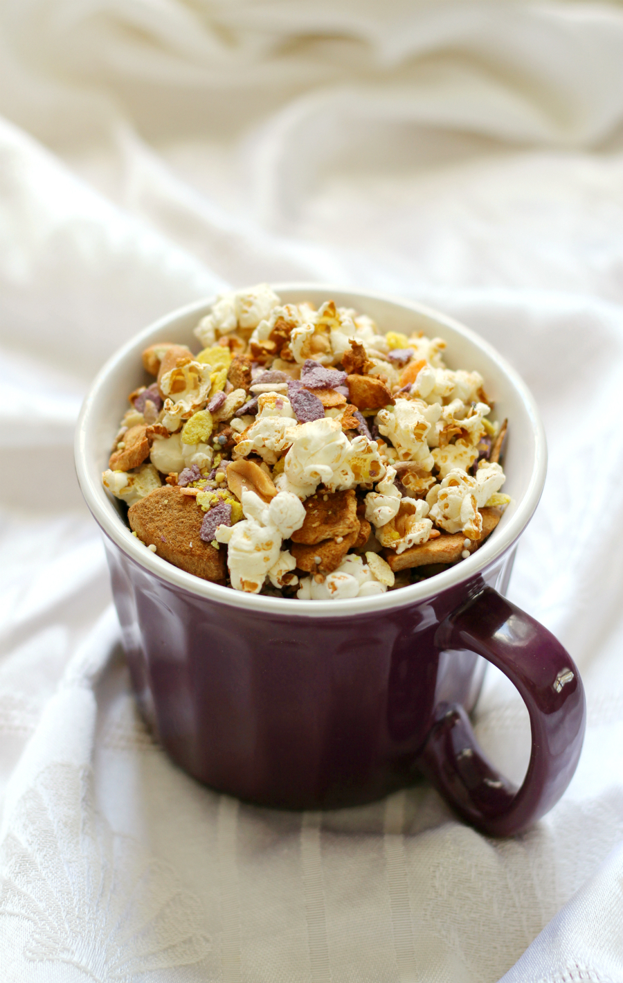 Circus Popcorn | Strength and Sunshine @RebeccaGF666 A healthier snack mix that the kids will love and will have fun making! A gluten-free, vegan, easy recipe for Circus Popcorn! Loaded with allergy-free Rainbow Rocks, sprinkles. peanuts, apple, and of course, fresh popcorn, all baked in the oven! Perfect for any kid-friendly party!