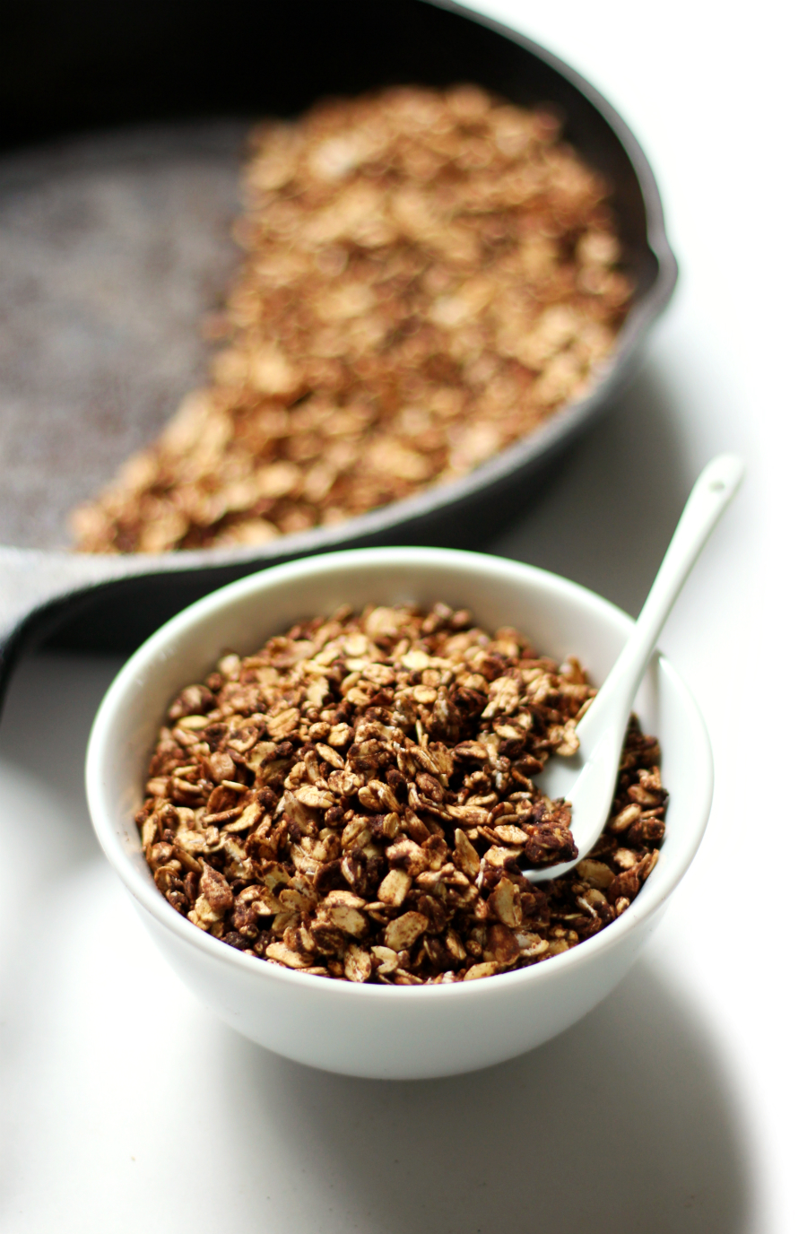 Mint Chocolate Skillet Granola | Strength and Sunshine @RebeccaGF666 Minty, chocolatey, and made right on the stove in the cast iron skillet! A Mint Chocolate Skillet Granola recipe that's gluten-free, vegan, nut-free, and allergy-free! Perfect for breakfast, as a snack, or dessert topping!