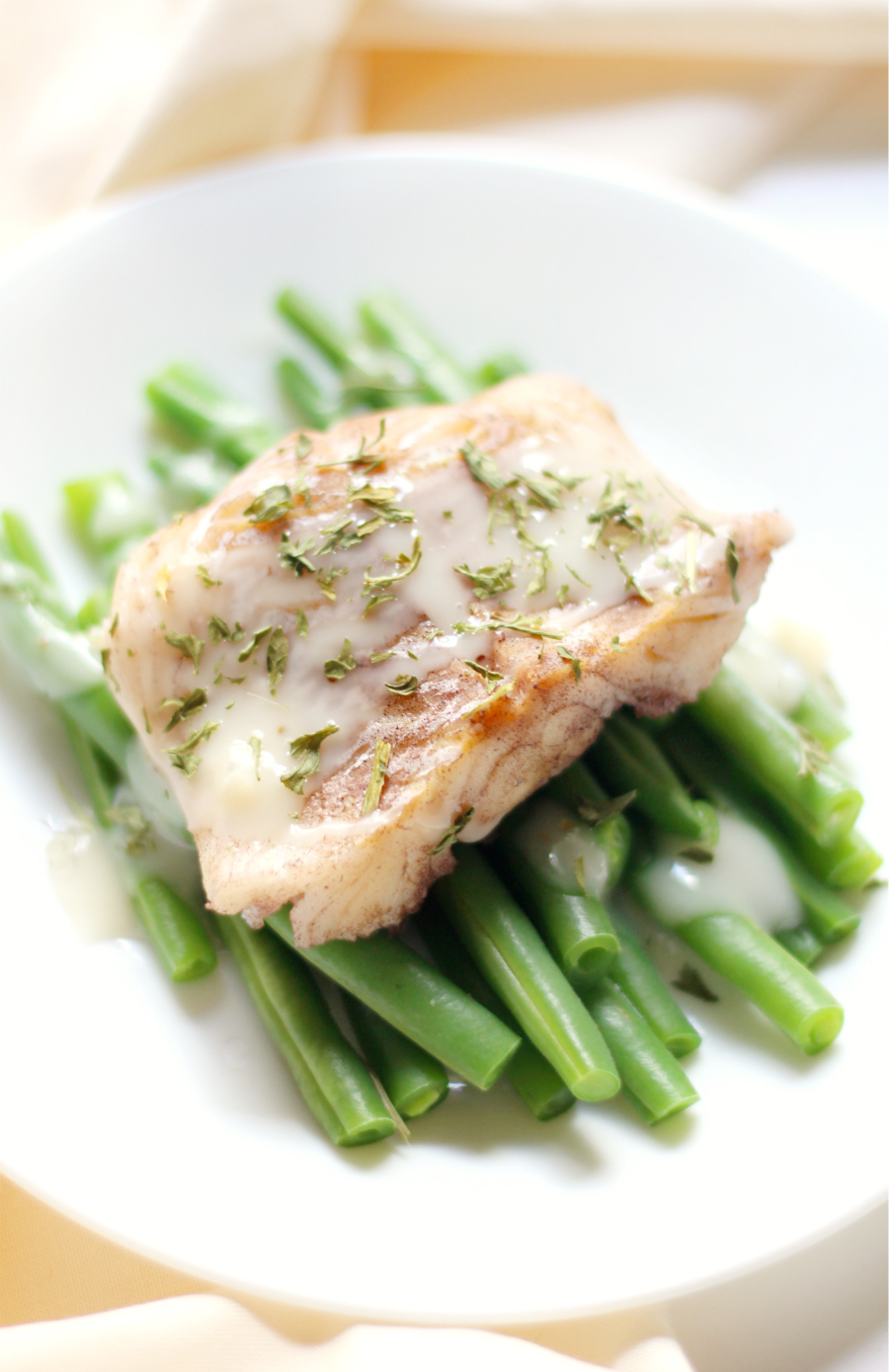 Wine Poached Cod with Sweet Onion Drizzle | Strength and Sunshine @RebeccaGF666 Treat yourself to an easy and elegant dinner of Wine Poached Cod with Sweet Onion Drizzle. This recipe is gluten-free, dairy-free, egg-free, nut-free, paleo, and perfect for a luxurious date night without all the fuss!