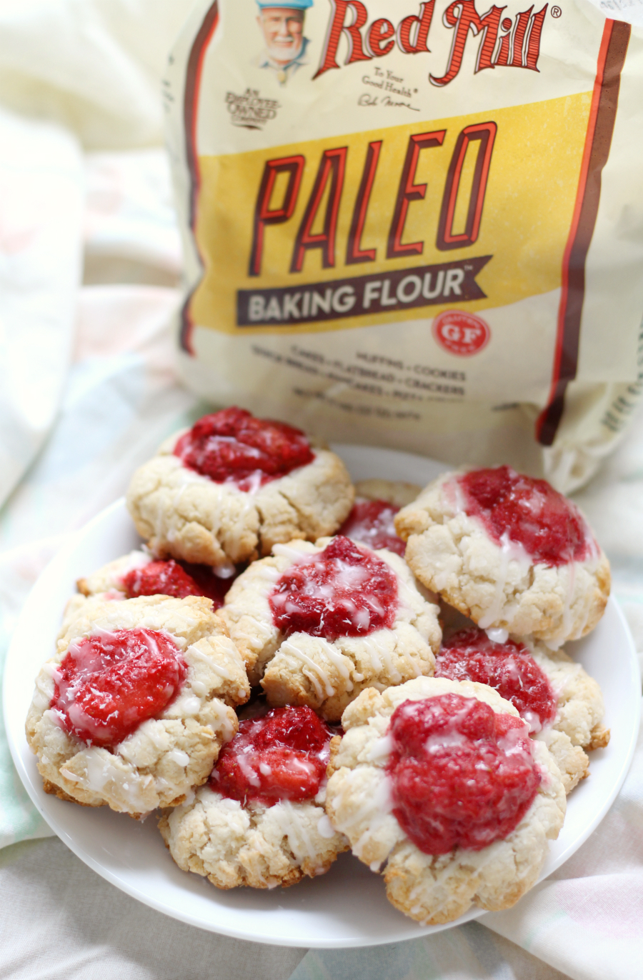 Paleo Strawberry Coconut Thumbprint Cookies (Gluten-Free, Vegan) | Strength and Sunshine @RebeccaGF666 Celebrate the Spring with a batch of Paleo Strawberry Coconut Thumbprint Cookies that are gluten-free, vegan, and grain-free! A fruity dessert recipe you'll be baking up beyond the season! ad BobsSpringBaking @BobsRedMill