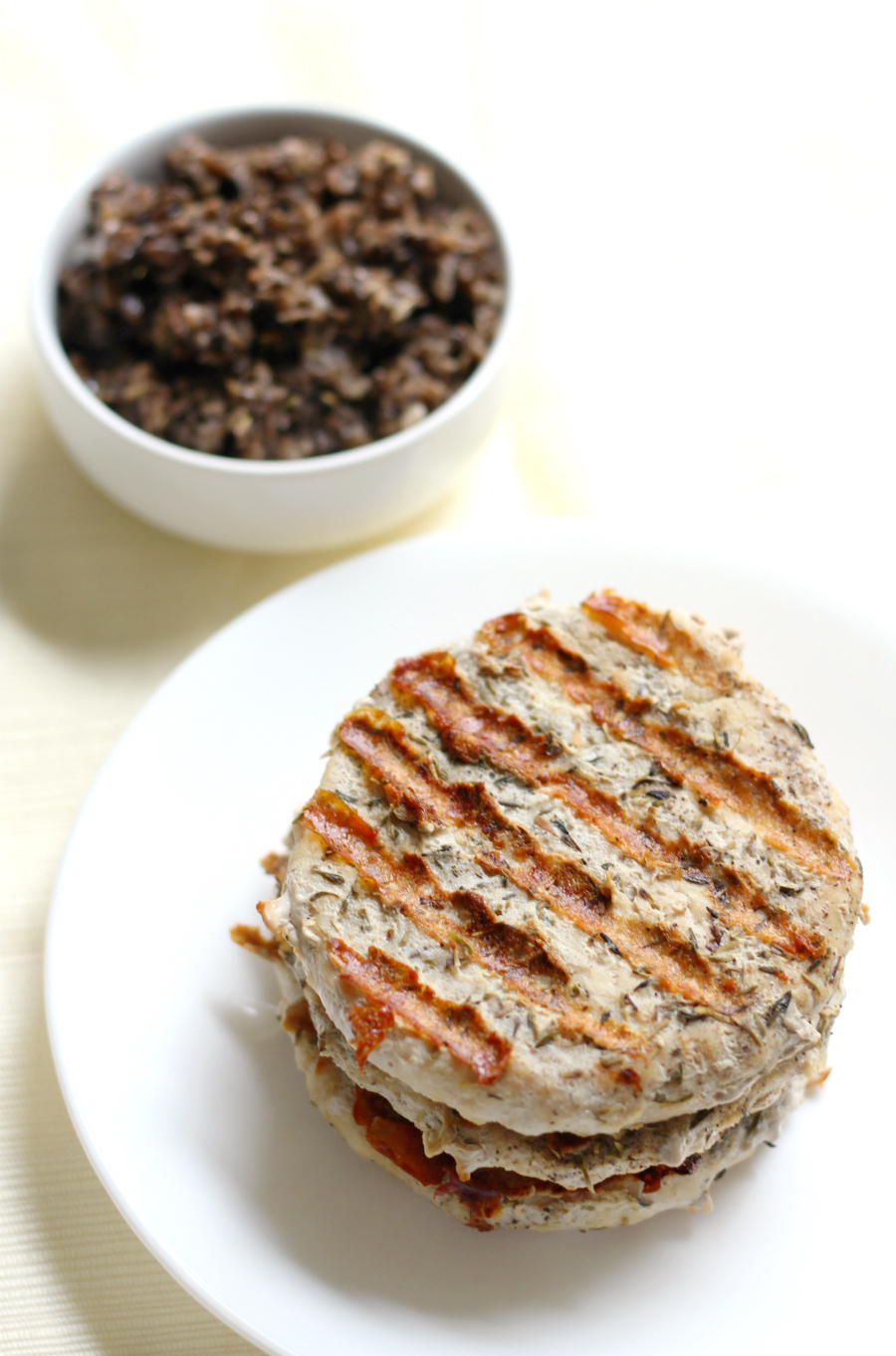 Grilled Chicken Burgers with Black Olive Tapenade (Gluten-Free, Paleo) | Strength and Sunshine @RebeccaGF666 Quick and easy Grilled Chicken Burgers with Black Olive Tapenade that are gluten-free, paleo, and allergy-free! Classic herb flavors with a salty bite from the homemade tapenade will make for a stand out healthy summer dinner recipe!