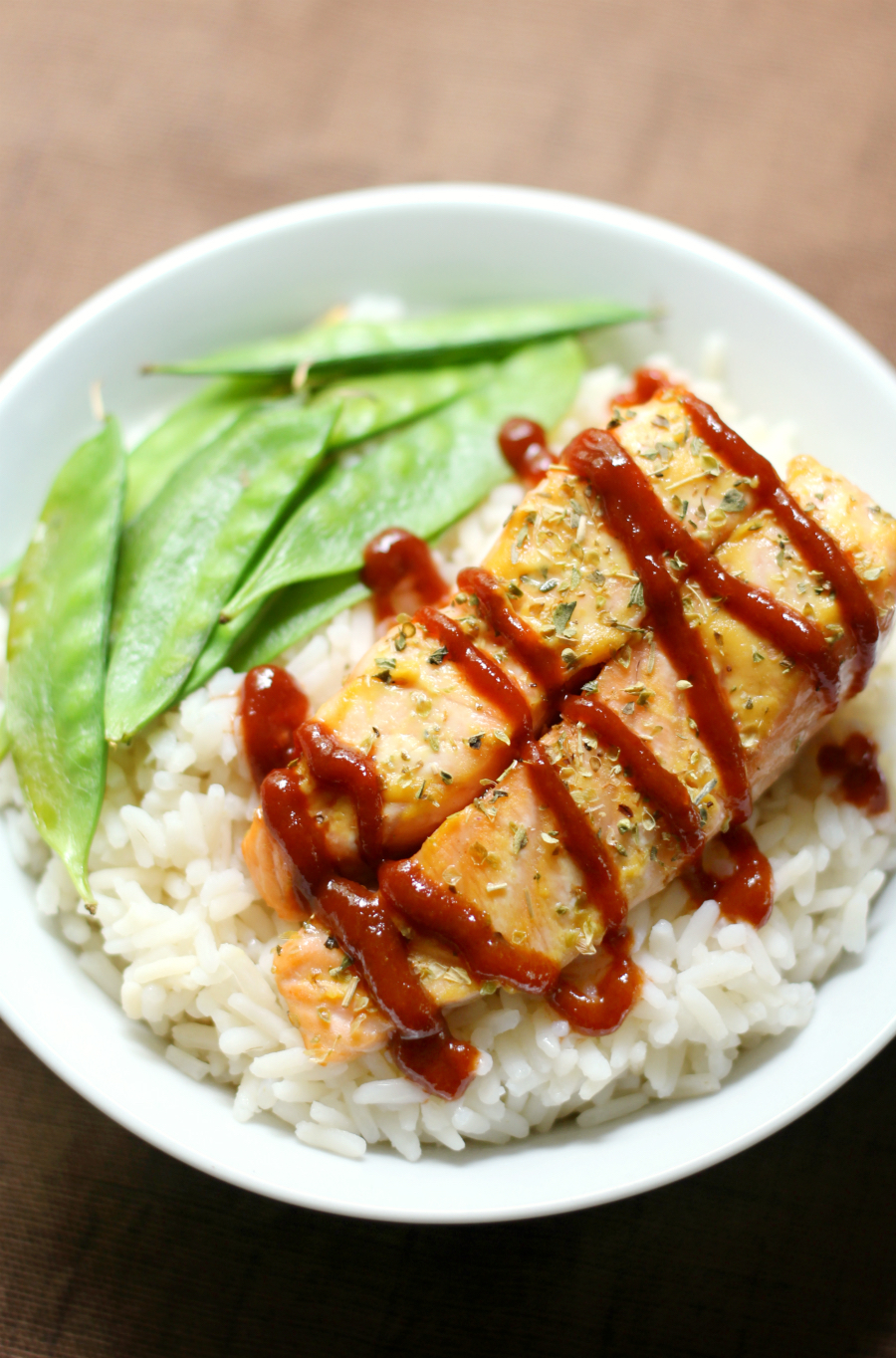 Sriracha Honey Mustard Salmon (Gluten-Free, Paleo) | Strength and Sunshine @RebeccaGF666 Spicy and tamed with a little sweetness! Sriracha Honey Mustard Salmon that's gluten-free, paleo, rich, and super flavorful! This recipe is an easy way to amp up the flavor and bring a healthy meal to the dinner table in a flash!