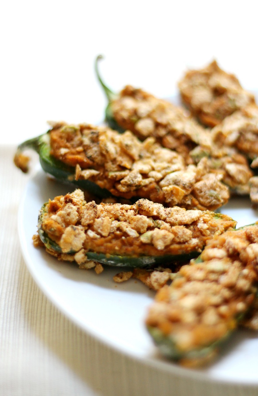 Gluten-Free Baked Jalapeño Poppers (Vegan, Allergy-Free) | Strength and Sunshine @RebeccaGF666 Your favorite spicy appetizer right got a healthy makeover! These Gluten-Free Baked Jalapeño Poppers are not only poppin', but vegan, top-8 allergy-free, and require no oil. Filled with a delicious creamy hummus and crusted for crunchy perfection, this recipe will be gone in a flash! #jalapeñopoppers #appetizer #vegan #glutenfree