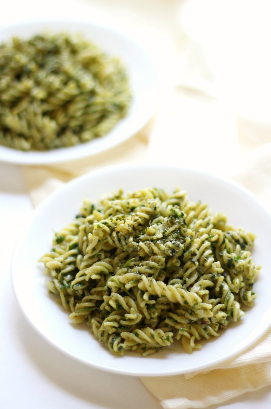 "Easy Gluten-Free Vegan Pesto Pasta | Strength and Sunshine @RebeccaGF666 A quick, delicious, Easy Gluten-Free Vegan Pesto Pasta recipe that can be ready and on the table in 10 minutes! A healthier dairy-free pesto with the rich flavors of olive oil, walnuts, fresh herbs, and spices will have you saying ""good-bye"" to boring pasta dinners! #pesto #pasta #glutenfree #vegan"