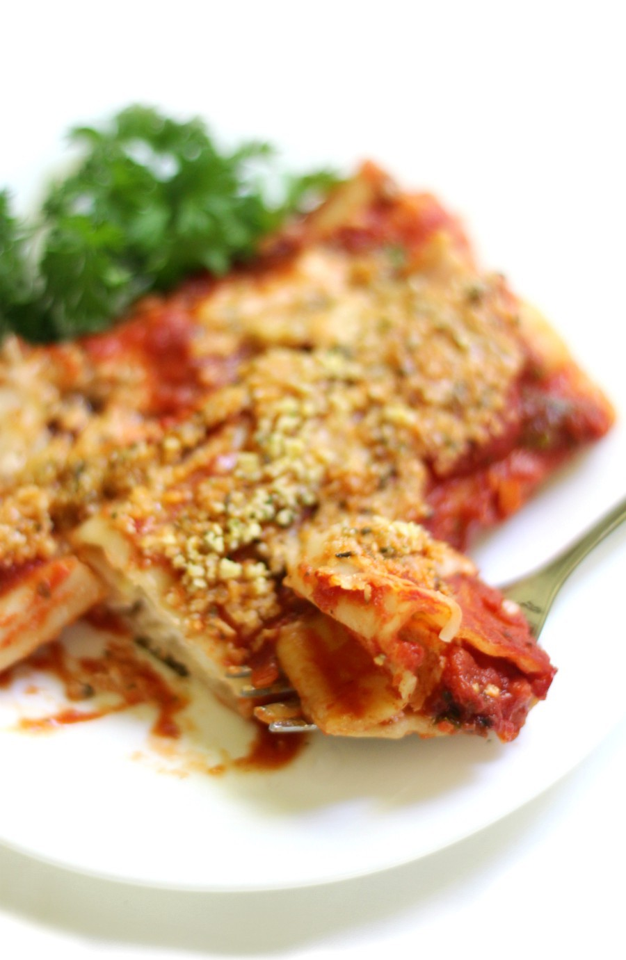 "Classic Baked Gluten-Free + Vegan Manicotti (Soy-Free) | Strength and Sunshine @RebeccaGF666 No more missing out on your Italian favorite! A Classic Baked Gluten-Free & Vegan Manicotti recipe with homemade tomato sauce, a creamy dairy-free & soy-free cheesy filling, all topped with a homemade 2-ingredient ""parmesan""! A perfect comfort food dinner the whole family will enjoy! #glutenfree #vegan #pasta #dinner #manicotti #dairyfree #soyfree #eggfree #glutenfreepasta"