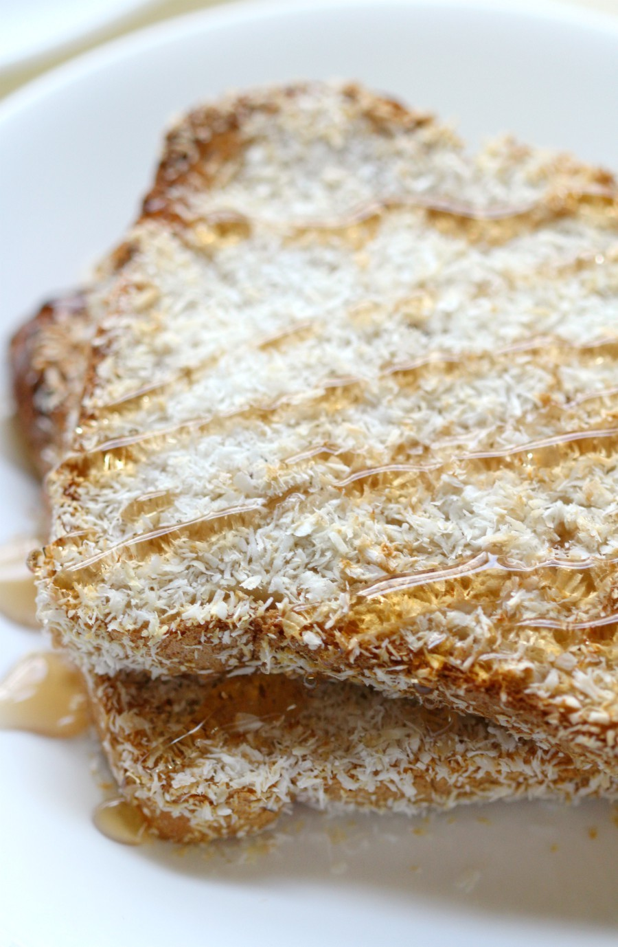 Air Fryer Toasted Coconut French Toast (Gluten-Free, Vegan) | Strength and Sunshine @RebeccaGF666 The healthiest way to make French toast for breakfast! Air Fryer Toasted Coconut French Toast made without the oil and is a gluten-free, vegan, & top 8 allergy-free recipe you'll love! No soggy bread and only 4 ingredients to crisp coconut perfection! #frenchtoast #breakfast #airfryer #glutenfree #vegan #coconut