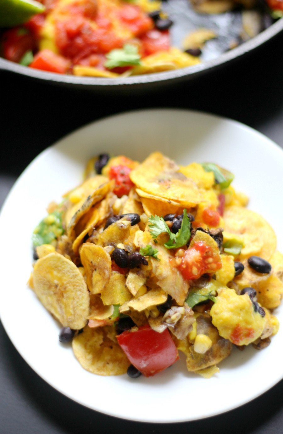 Gluten-Free Skillet Plantain Nachos (Vegan, Grain-Free, Allergy-Free) | Strength and Sunshine @RebeccaGF666 A delicious, messy, plant-based skillet of nachos! Gluten-Free Skillet Plantain Nachos that are vegan, grain-free, and top 8 allergy-free! Loaded with veggies and plantain chips, topped with salsa and an easy homemade vegan cheese sauce recipe, these nachos make for a fun Mexican meal any night of the week! #nachos #glutenfree #vegan #plantains #grainfree #strengthandsunshine