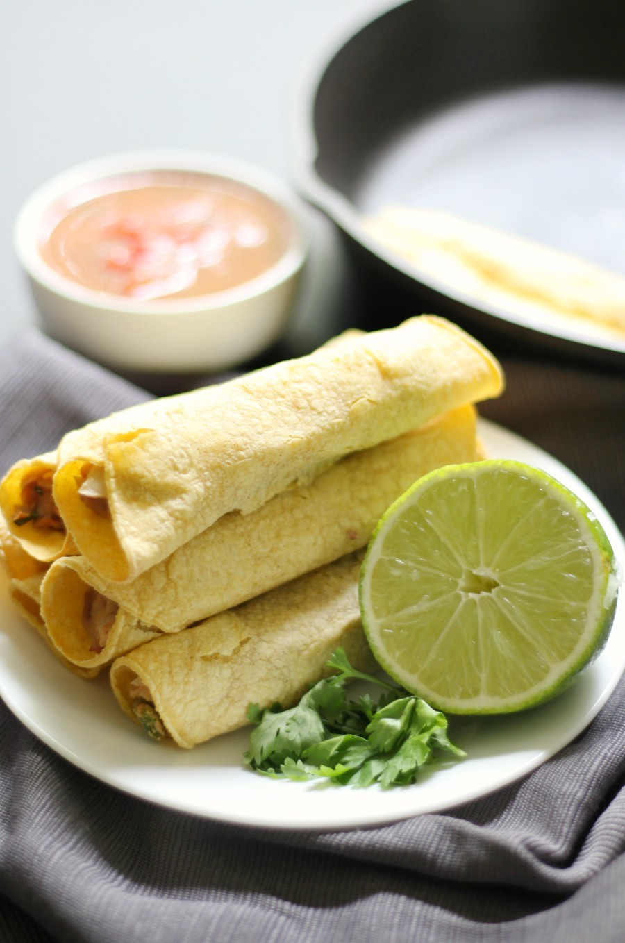 "Gluten-Free Baked Pinto Bean Taquitos (Vegan, Allergy-Free) | Strength and Sunshine @RebeccaGF666 Change up your taco routine with the Mexican ""rolled taco""! Gluten-Free Baked Pinto Bean Taquitos that are vegan, top 8 allergy-free, require no oil, and perfect as a dinner recipe or fun appetizer bite to feed a crowd! A spicy pinto bean filling, simply rolled in corn tortillas! #taquitos #glutenfree #vegan #mexicanfood #strengthandsunshine"