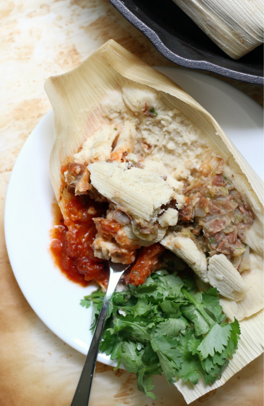 Gluten-Free Pinto Bean Tamales (Vegan, Allergy-Free) | Strength and Sunshine @RebeccaGF666 An easy Mexican tamale recipe with a homemade masa dough and spicy pinto bean filling. These Gluten-Free Pinto Bean Tamales are vegan and top 8 allergy-free, making them a great meatless weeknight meal the whole family will love! #tamales #pintobeans #glutenfree #vegan #mexican #allergyfree #strengthandsunshine