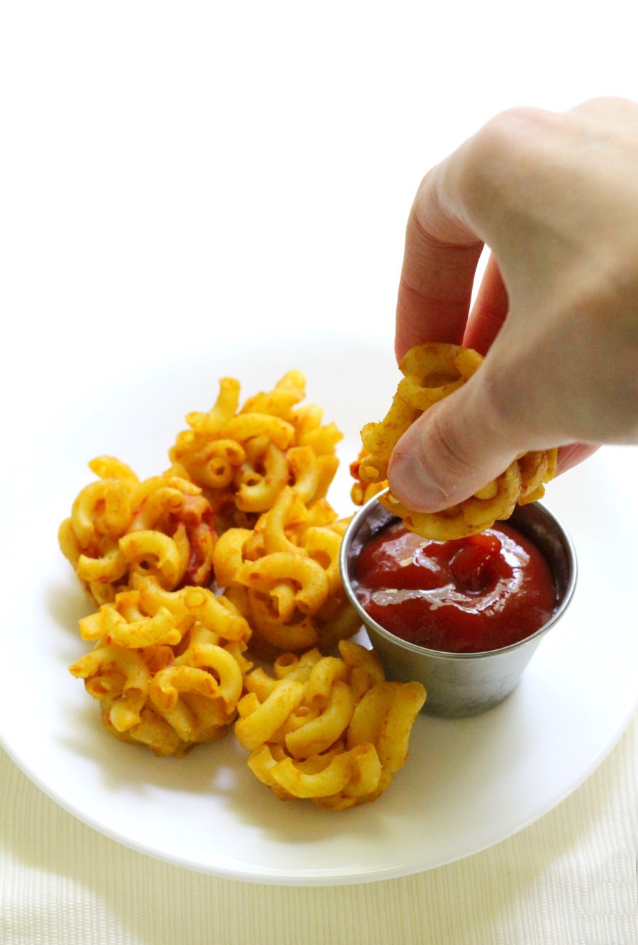 hand-dip-mac-and-cheese-bite-ketchup