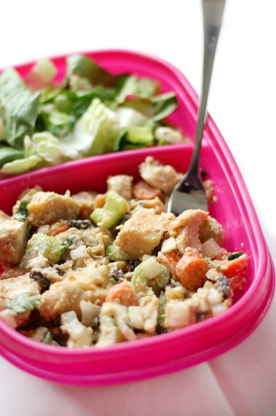 tahini-chicken-salad-in-pink-meal-prep-container