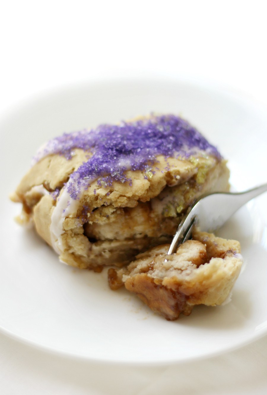 single-slice-gluten-free-king-cake-on-white-plate