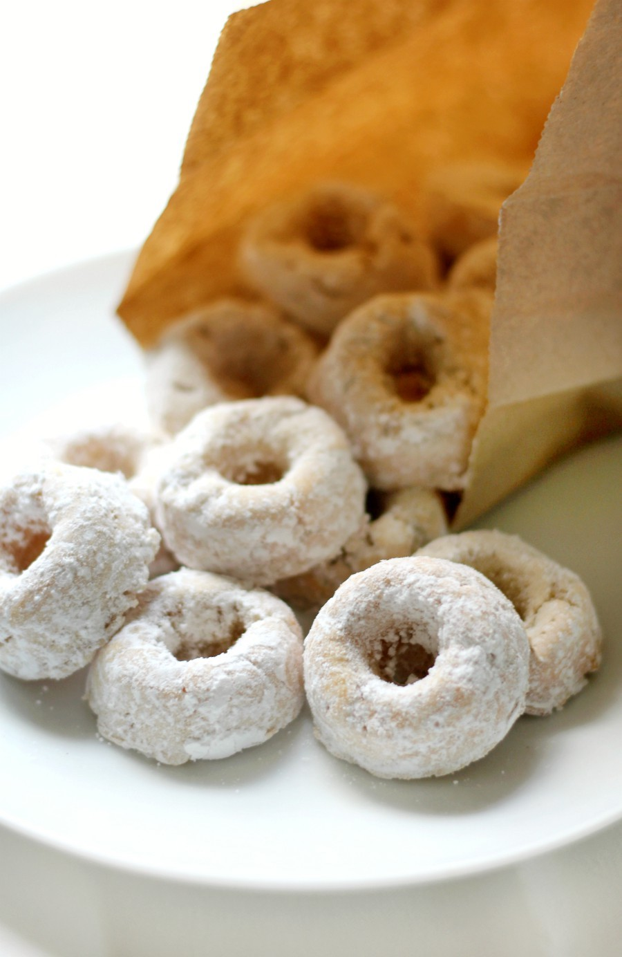 mini-powdered-doughnuts-close-up-in-brown-paper-bag