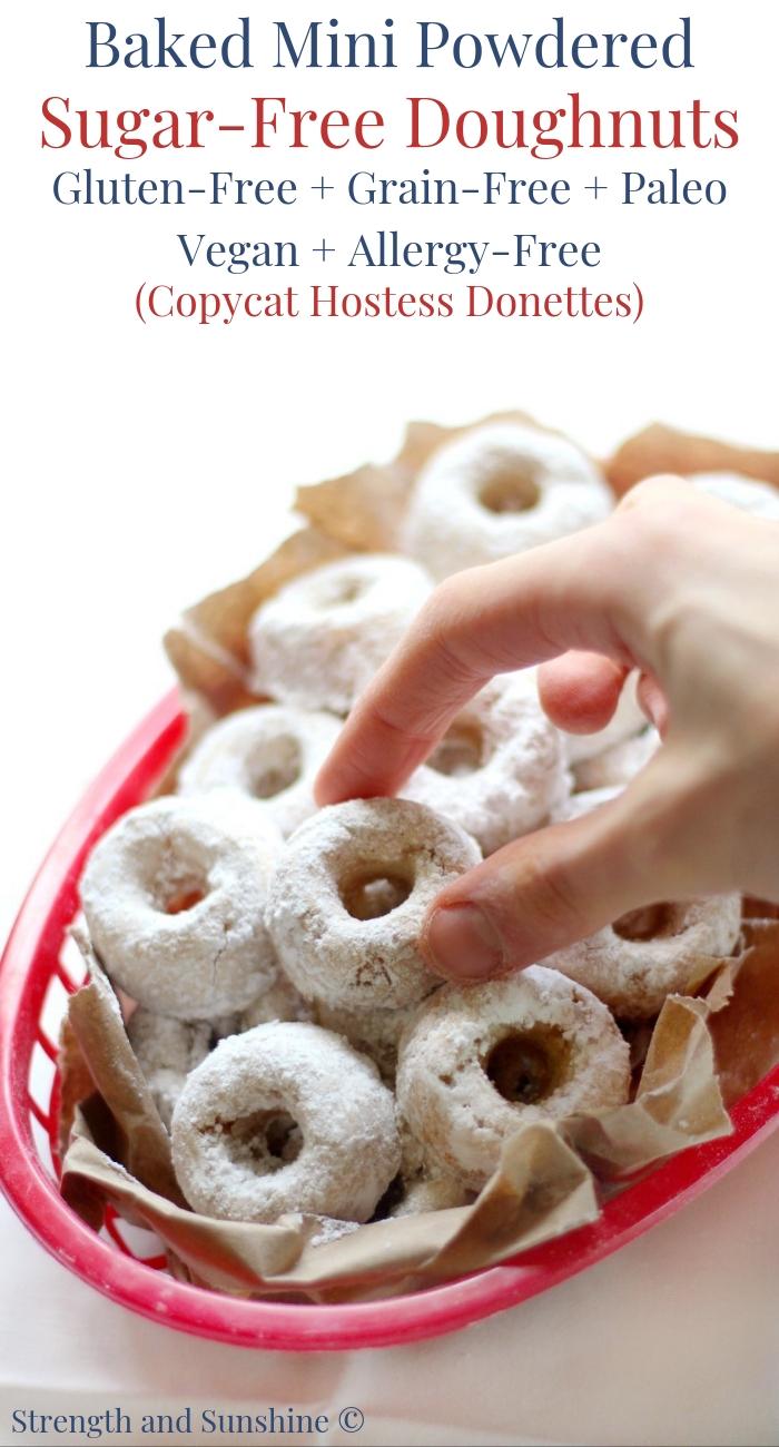 hand-grabbing-mini-powdered-doughnut-from-red-basket-pin