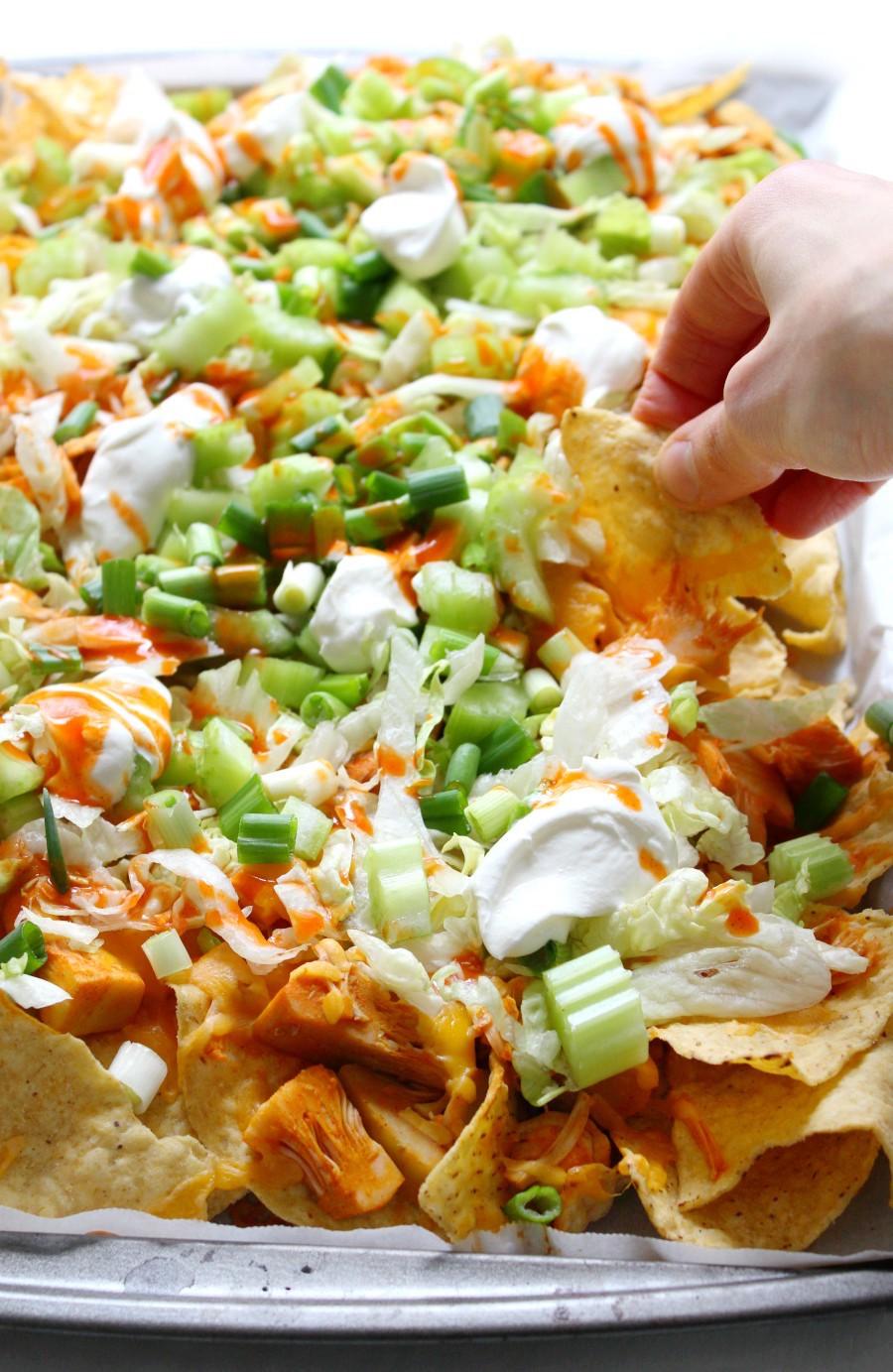 side-view-hand-vegan-buffalo-nachos