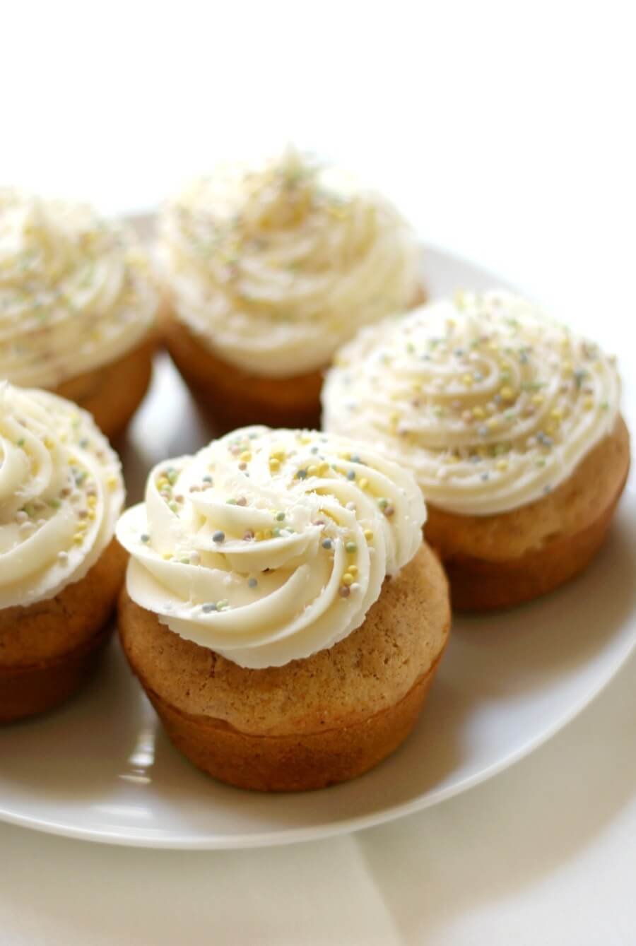 white plate with gluten-free vegan carrot cake cupcakes