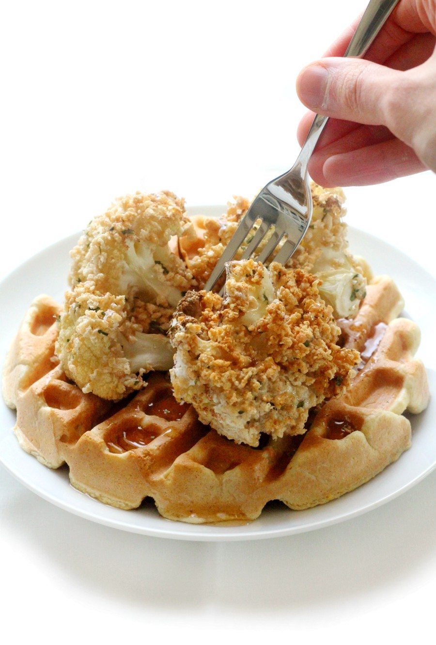 fork-and-hand-eating-gluten-free-vegan-chicken-and-waffles