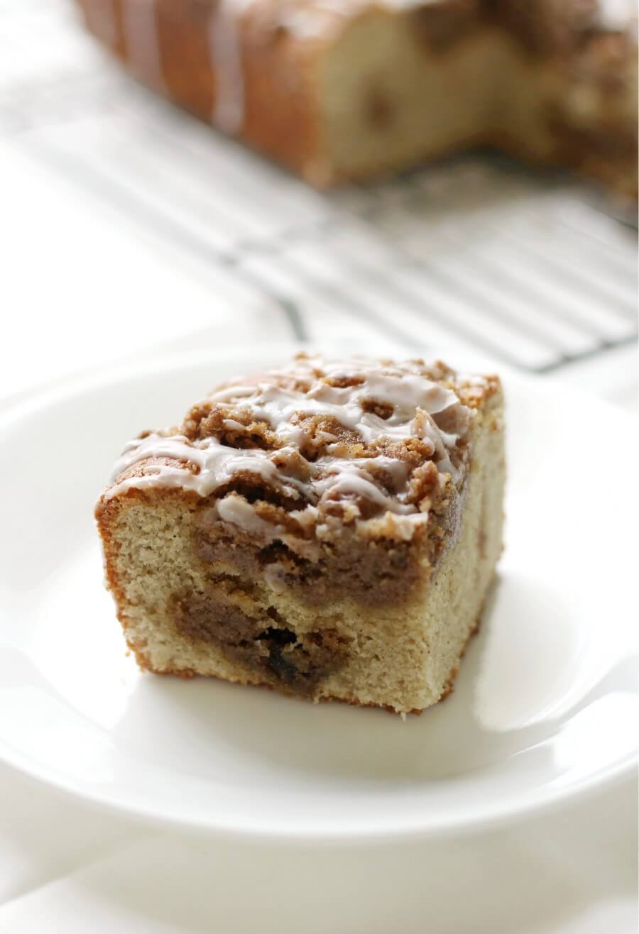 slice of gluten-free vegan coffee cake on a white plate
