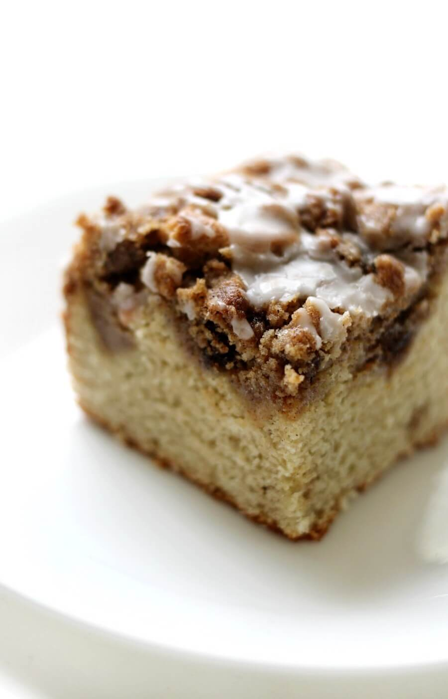 square slice of gluten-free coffee cake with cinnamon streusel