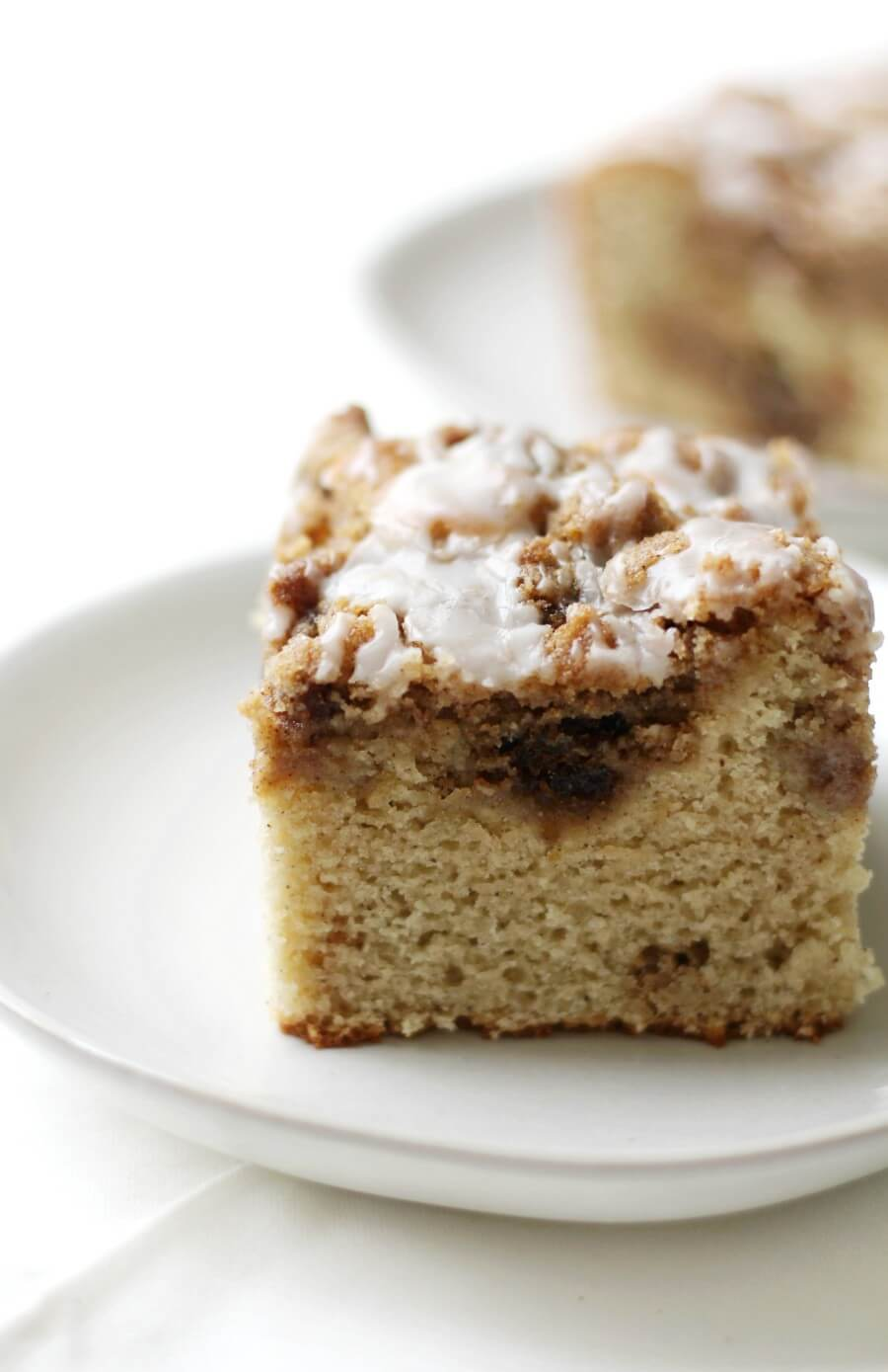 square of gluten-free coffee cake on a grey plate