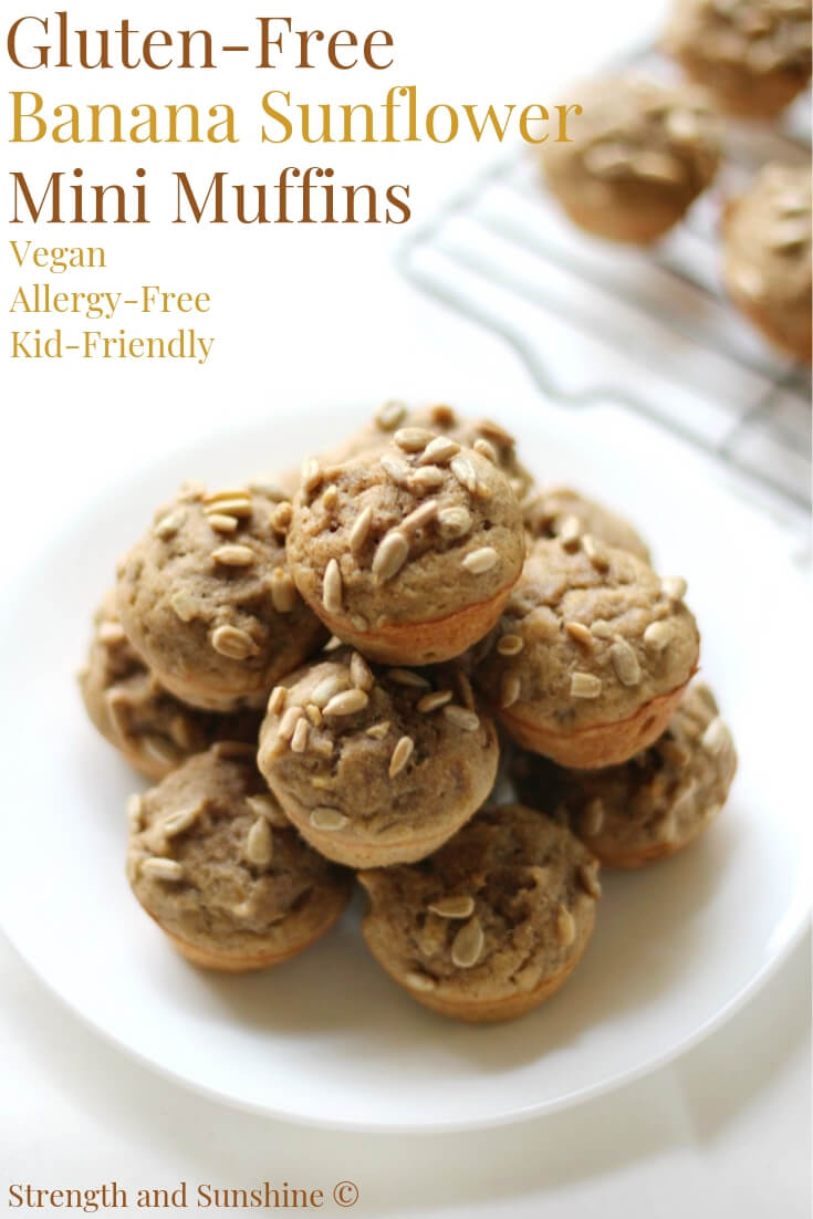 a plate of gluten-free banana sunflower mini muffins stacked up
