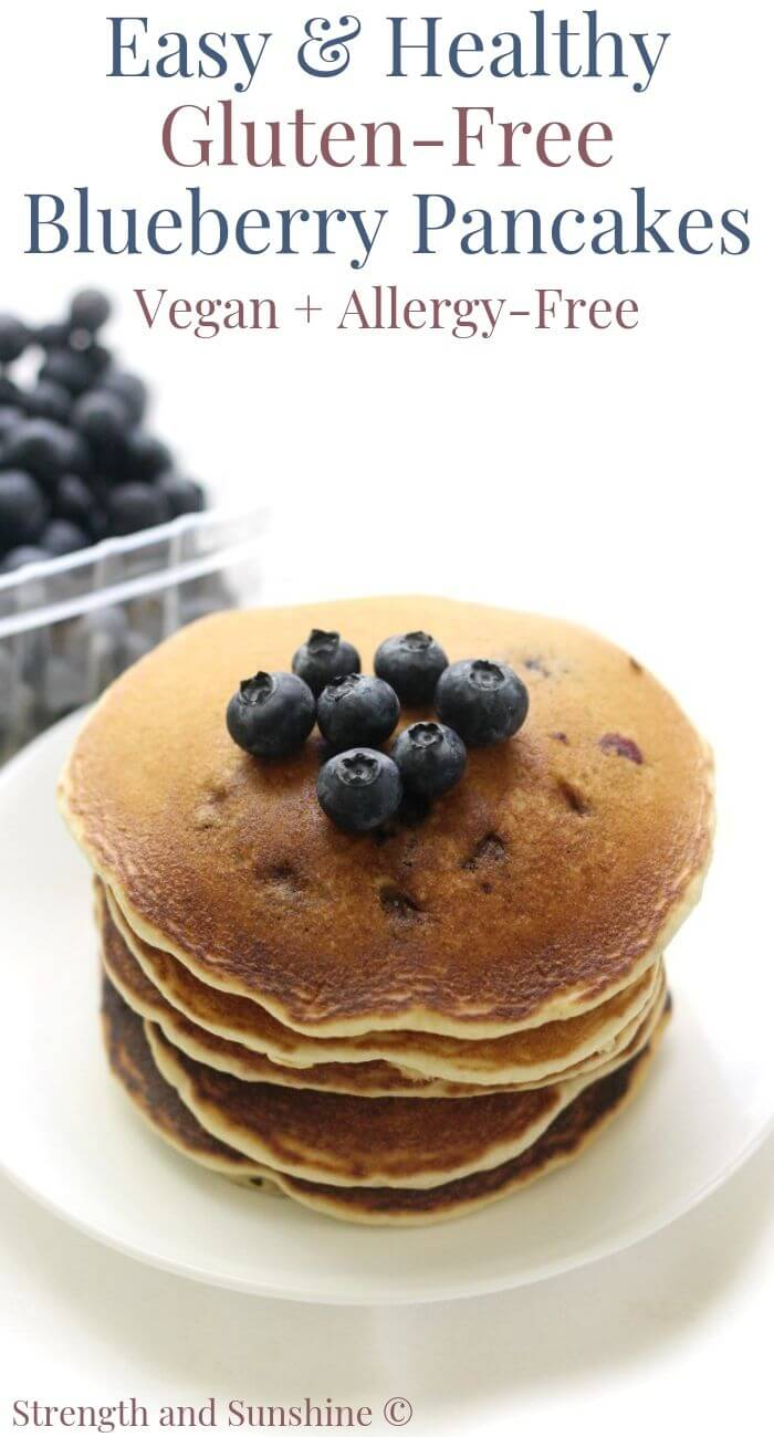 stack of gluten-free blueberry pancakes with carton of blueberries