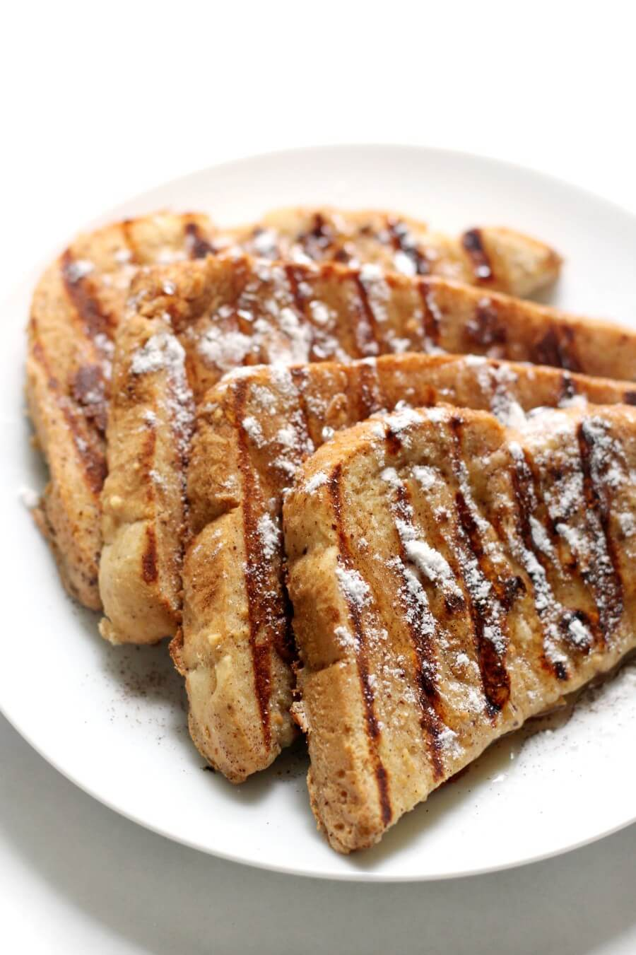 four pieces of gluten-free grilled French toast plated