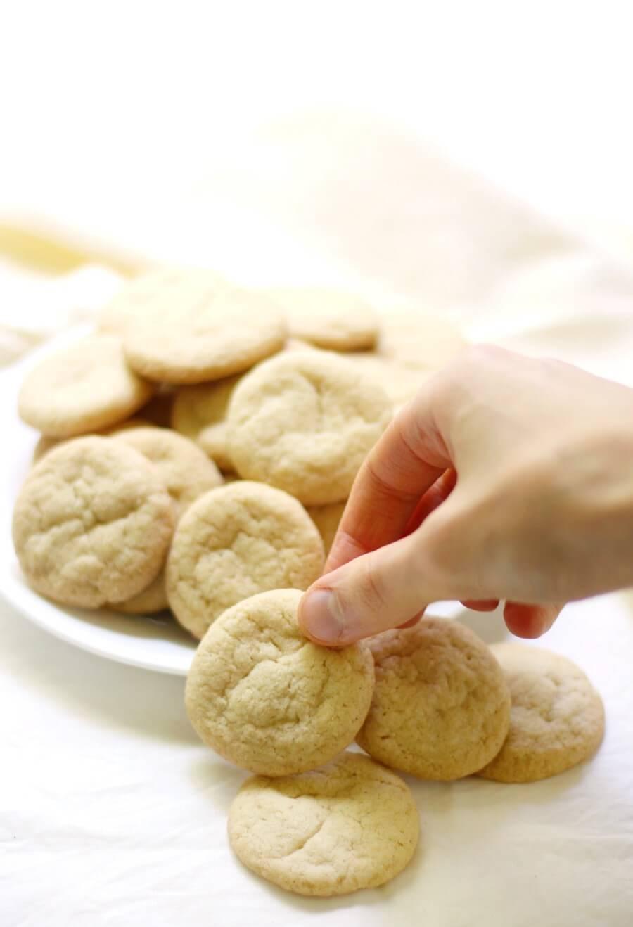hand grabbing a gluten-free homemade vanilla wafer