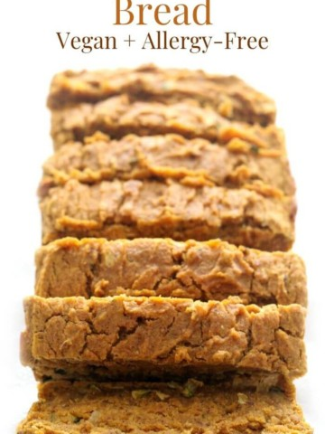 sliced loaf of gluten-free pumpkin zucchini bread with image text