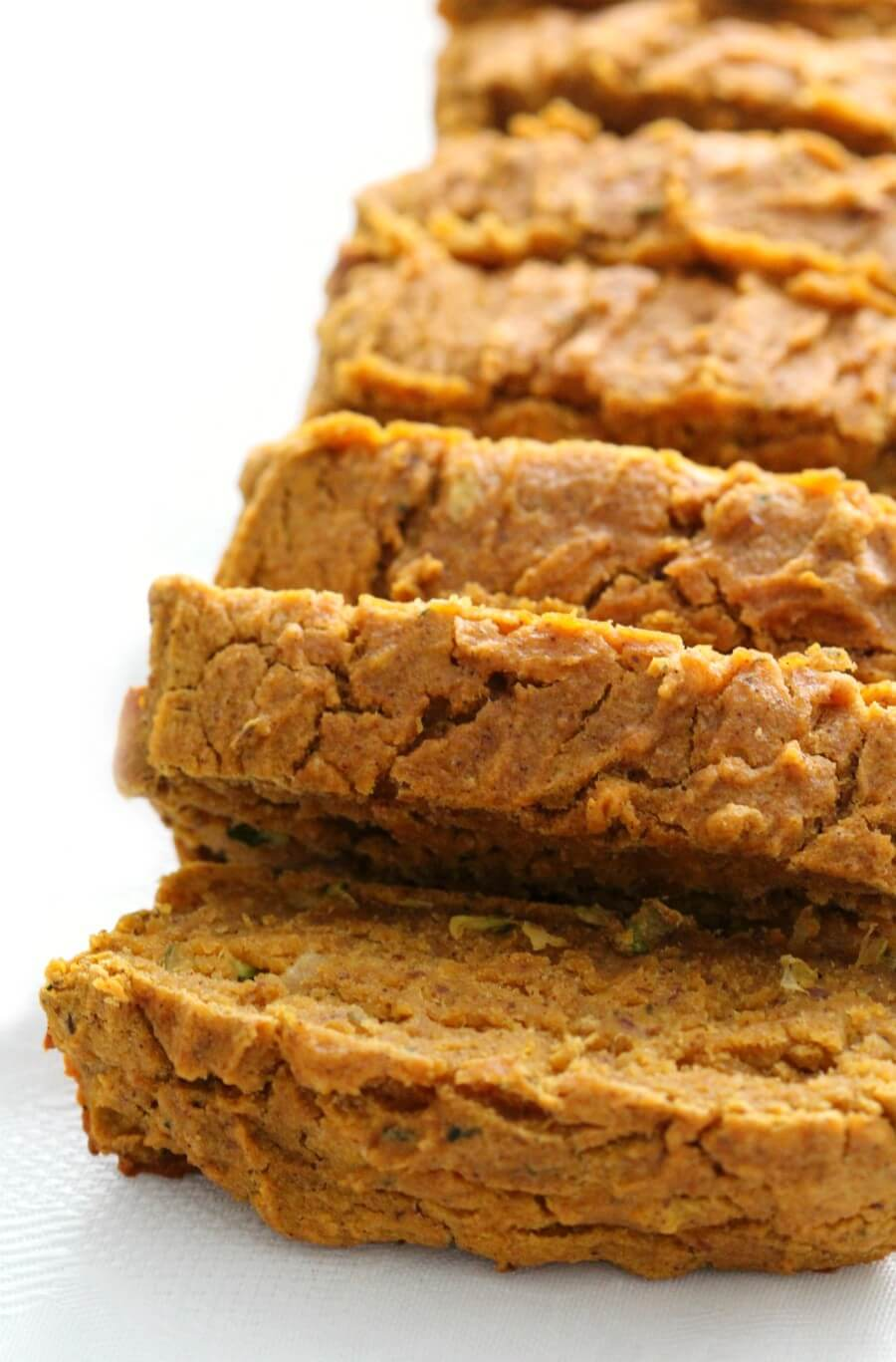 side of sliced gluten-free pumpkin zucchini bread loaf