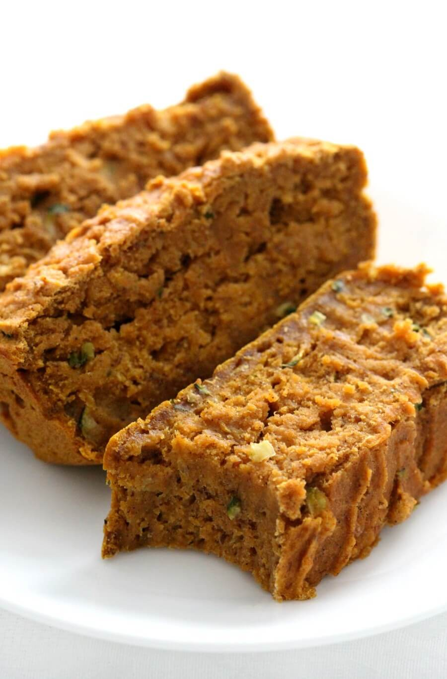 white plate with three slices of gluten-free pumpkin zucchini bread