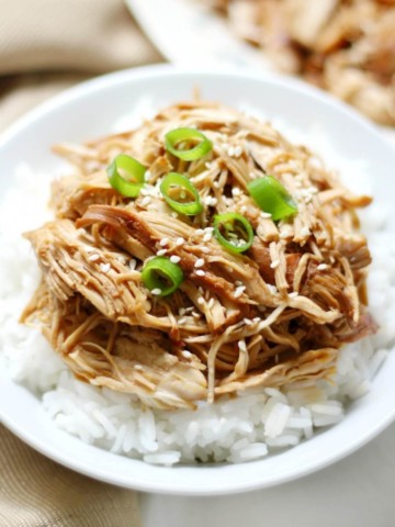 centered white bowl with rice and slow cooker teriyaki chicken
