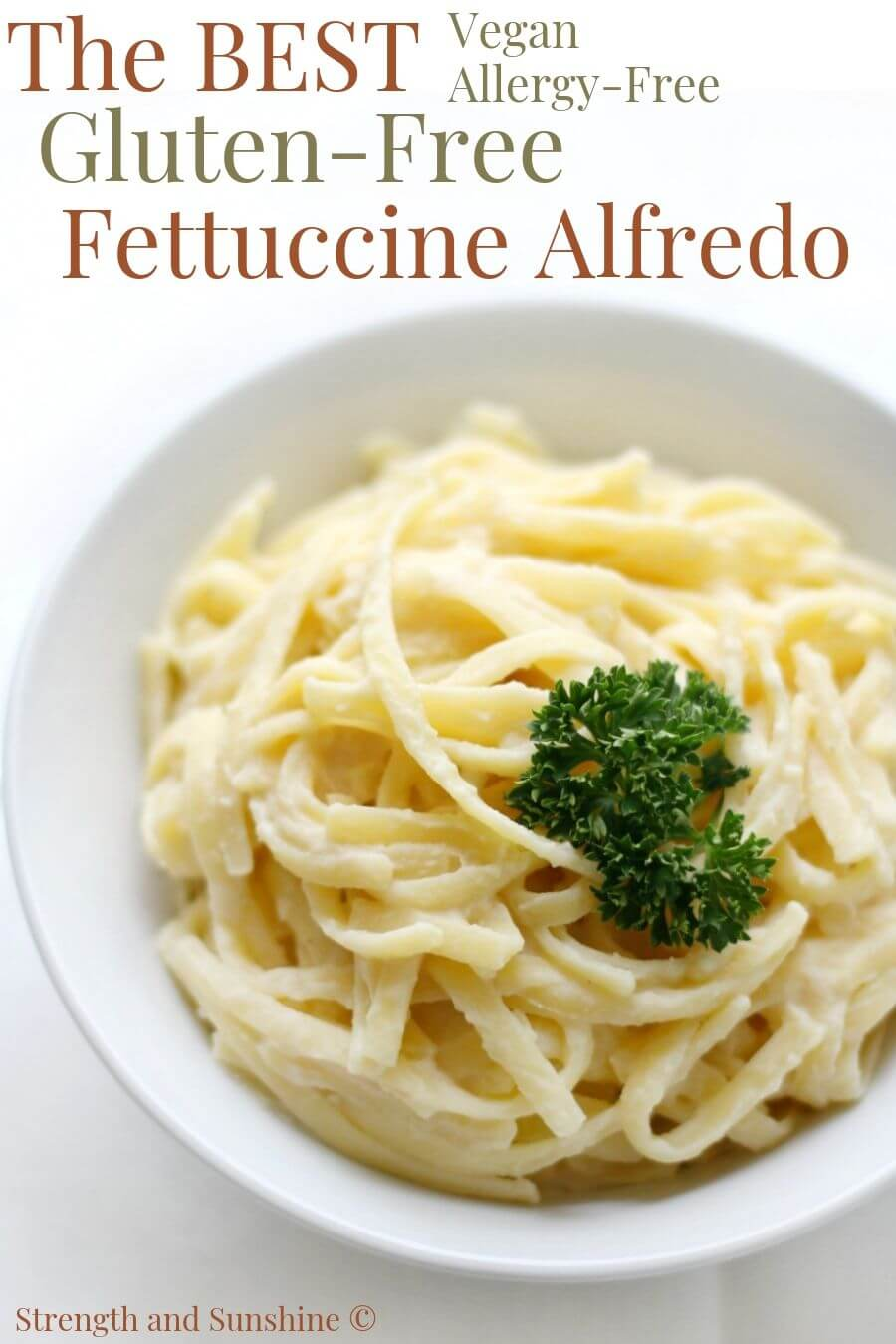 white bowl of gluten-free fettuccine alfredo with parsley and image text