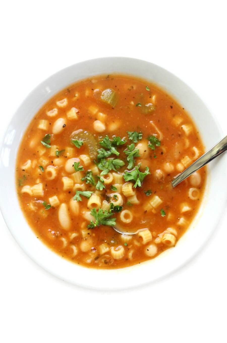 centered overhead shot of gluten-free pasta e fagioli in white bowl